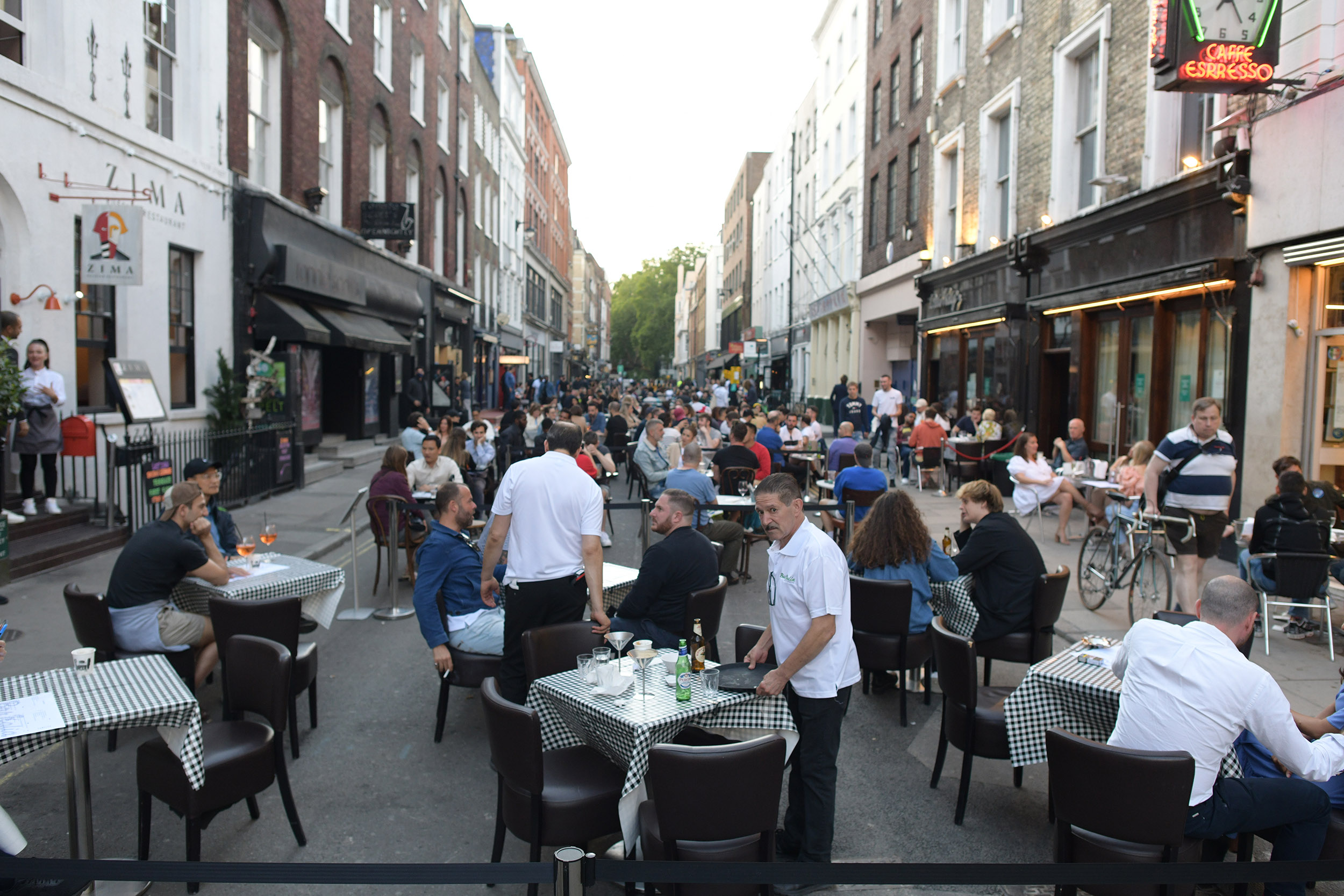 People socialize in Soho, central London, after the lifting of further coronavirus lockdown restrictions in England.