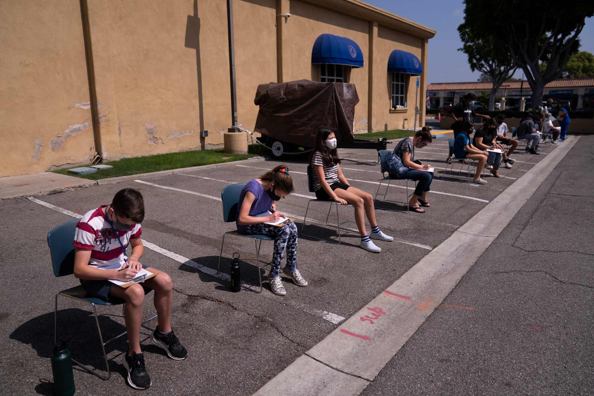 Children ages 12 to 15 wait to get their vitals checked before getting their Pfizer COVID-19 vaccine at Families Together of Orange County in Tustin, California, on May 13.