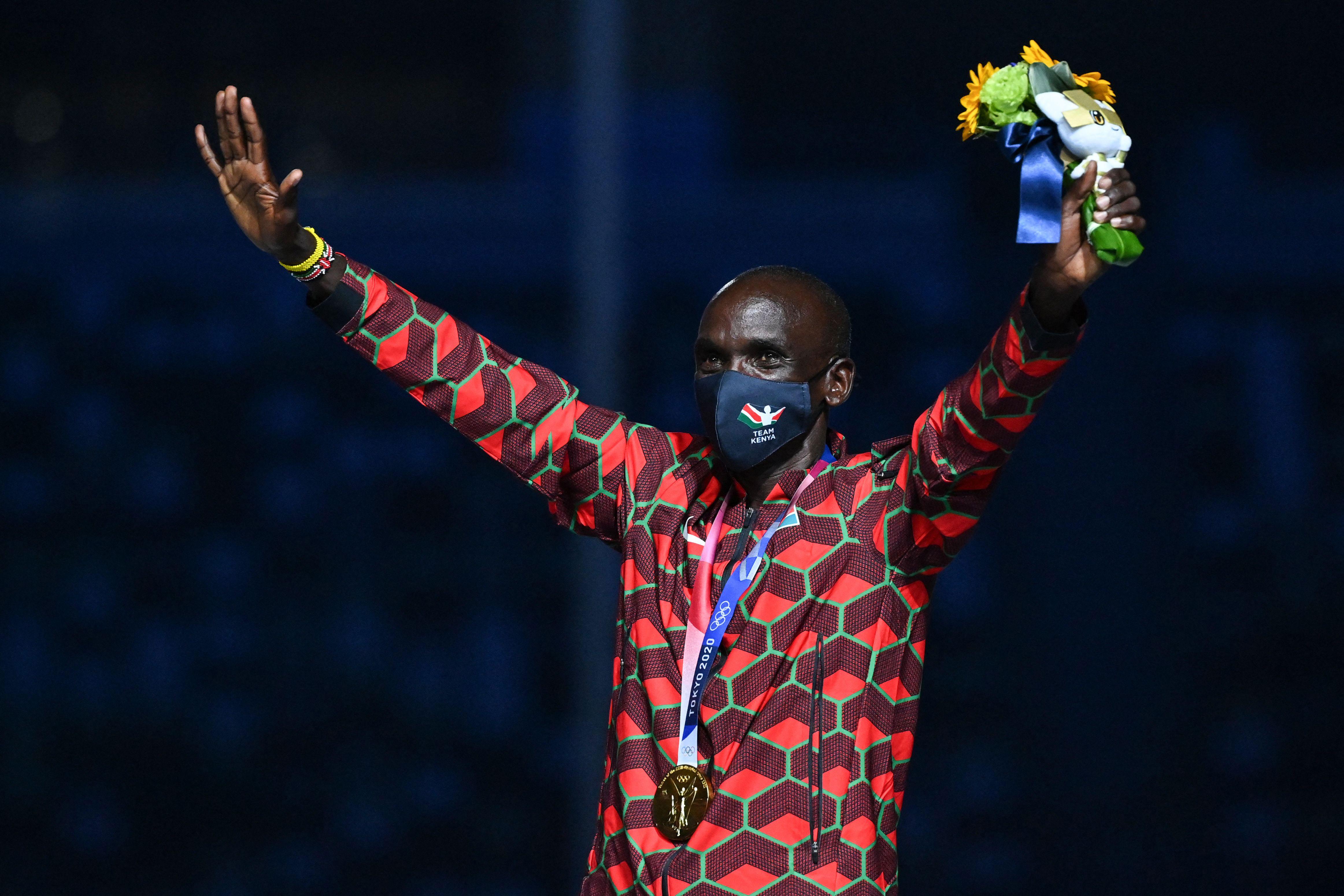Marathon winner Eliud Kipchoge, from Kenya, celebrates on the podium during the closing ceremony.