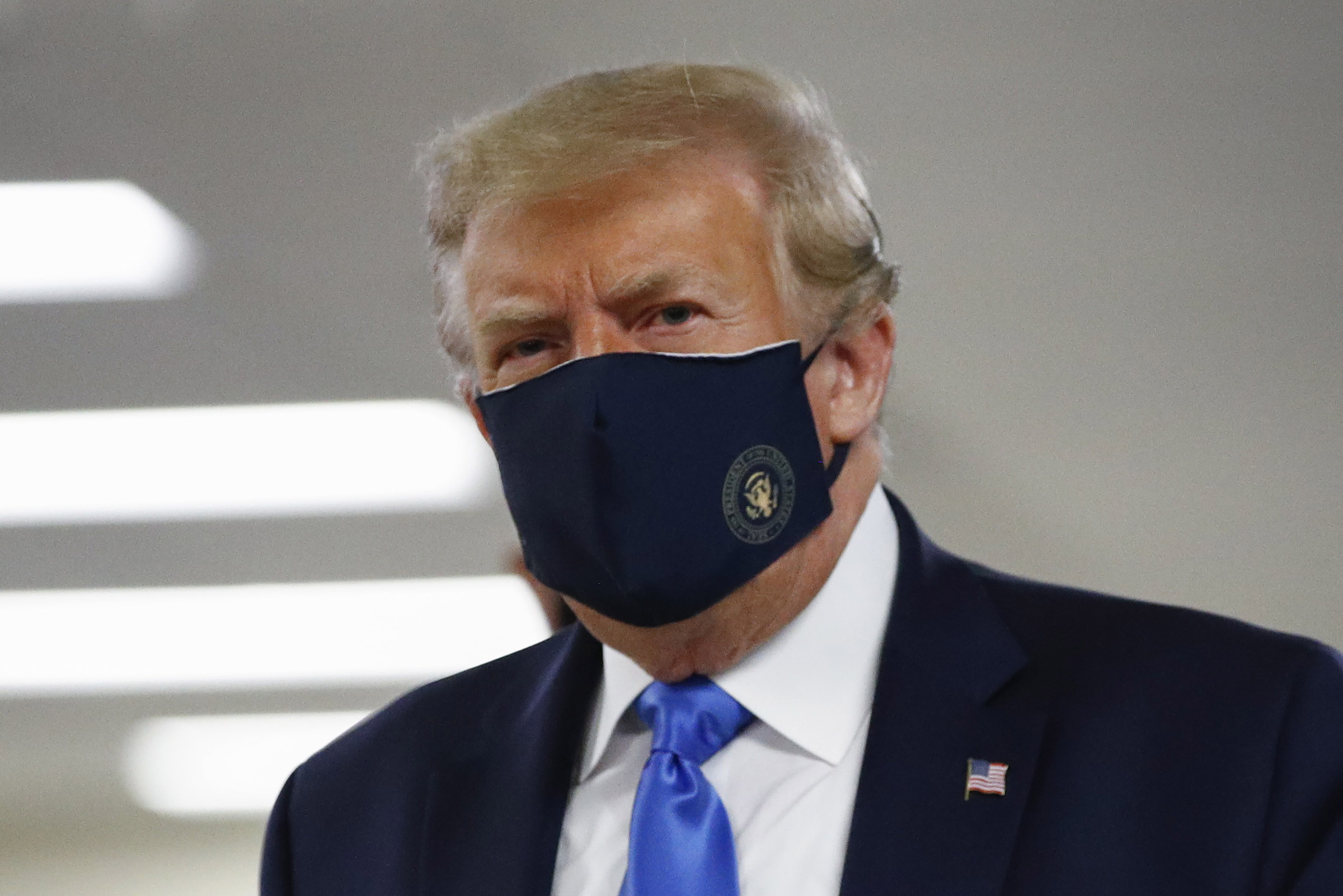 President Donald Trump wore a face mask during a visit at Walter Reed National Military Medical Center in Bethesda, Maryland, on Saturday, July 11.