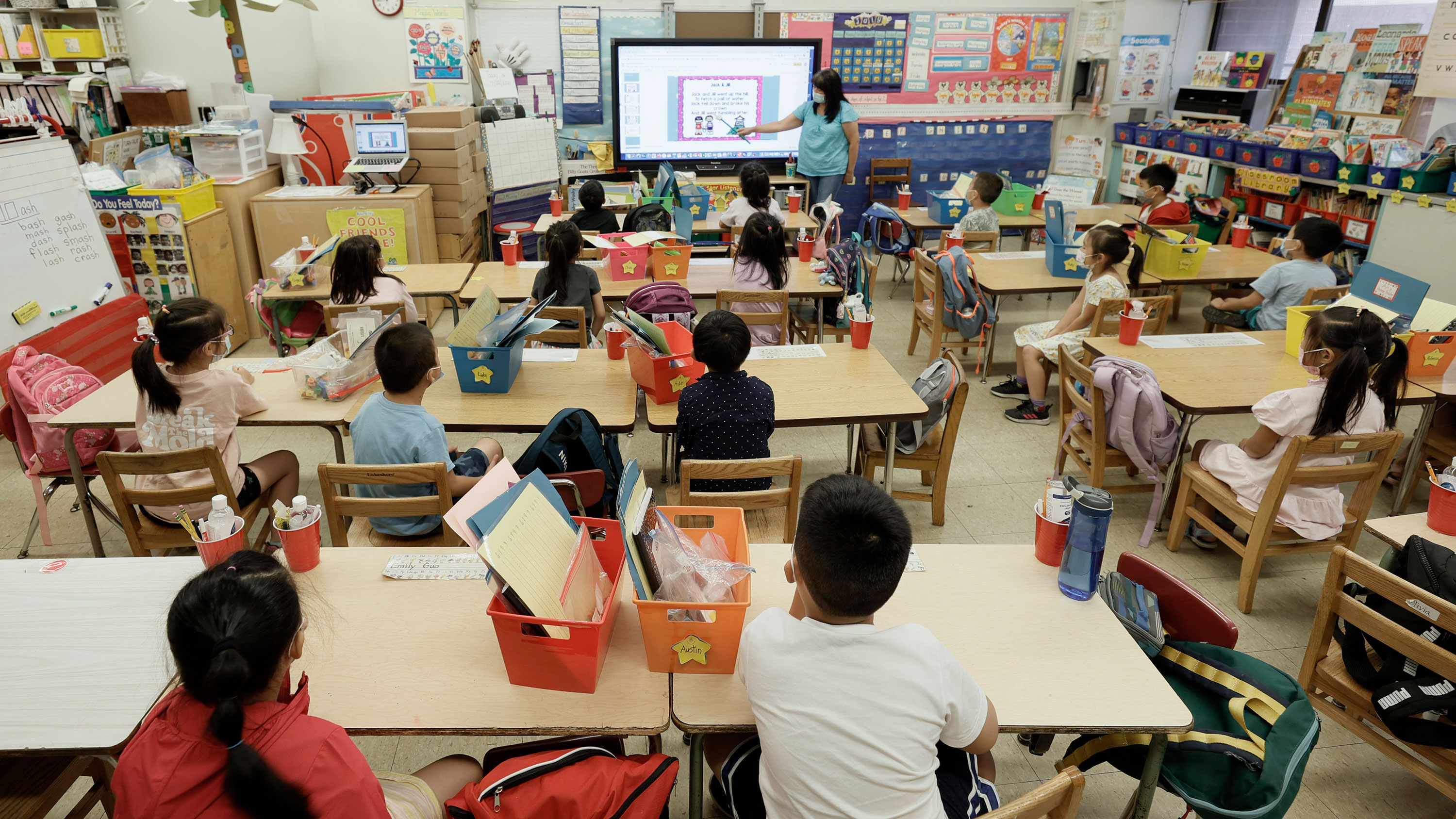 A teacher at Yung Wing School in New York, goes over a lesson on a monitor with in-person Summer program students on July 22, 2021 in New York City. Positive COVID-19 cases in some New York City public schools have resulted in classroom quarantines.(Photo by Michael Loccisano/Getty Images)
