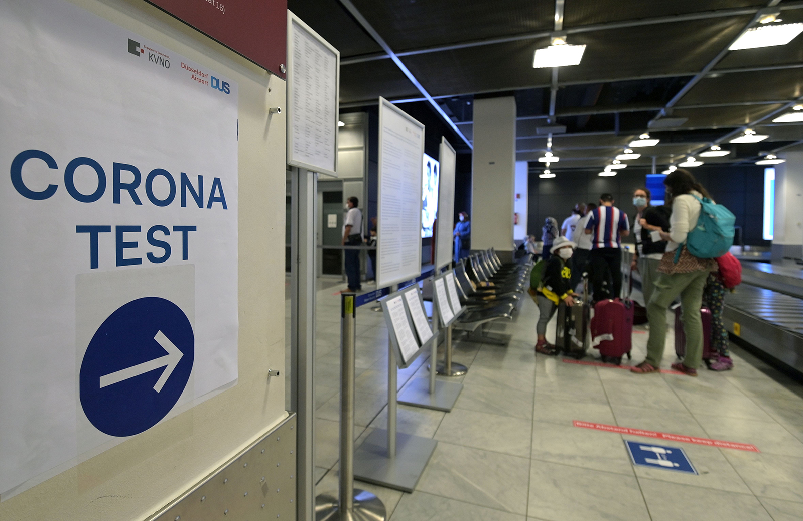 A sign directs traffic to a coronavirus screening station in the medical center of the airport in Duesseldorf, western Germany, on Monday, July 27.