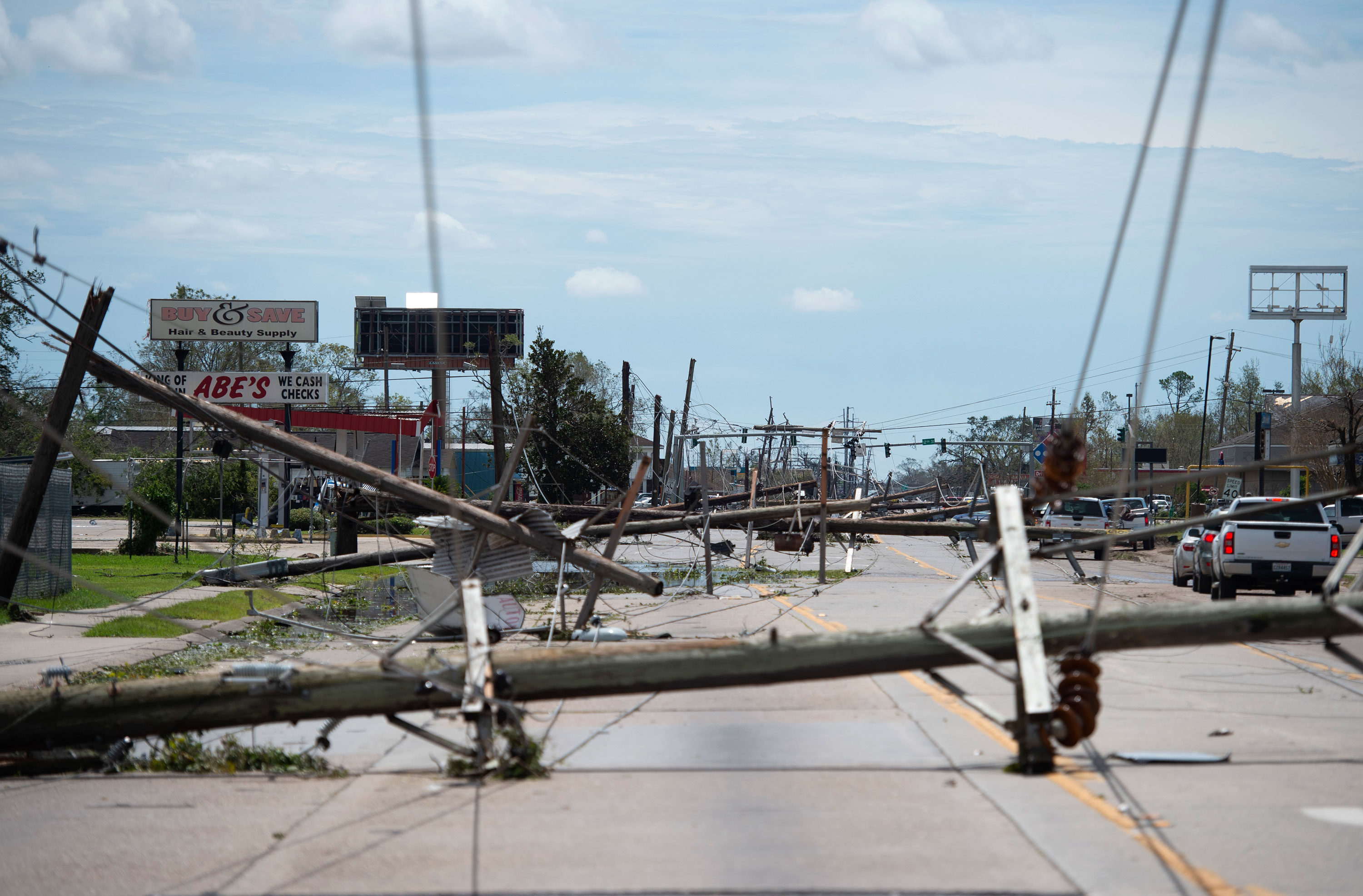 Downed power lines block a road after hurricane Laura passed through Lake Charles, Louisiana, on August 27.