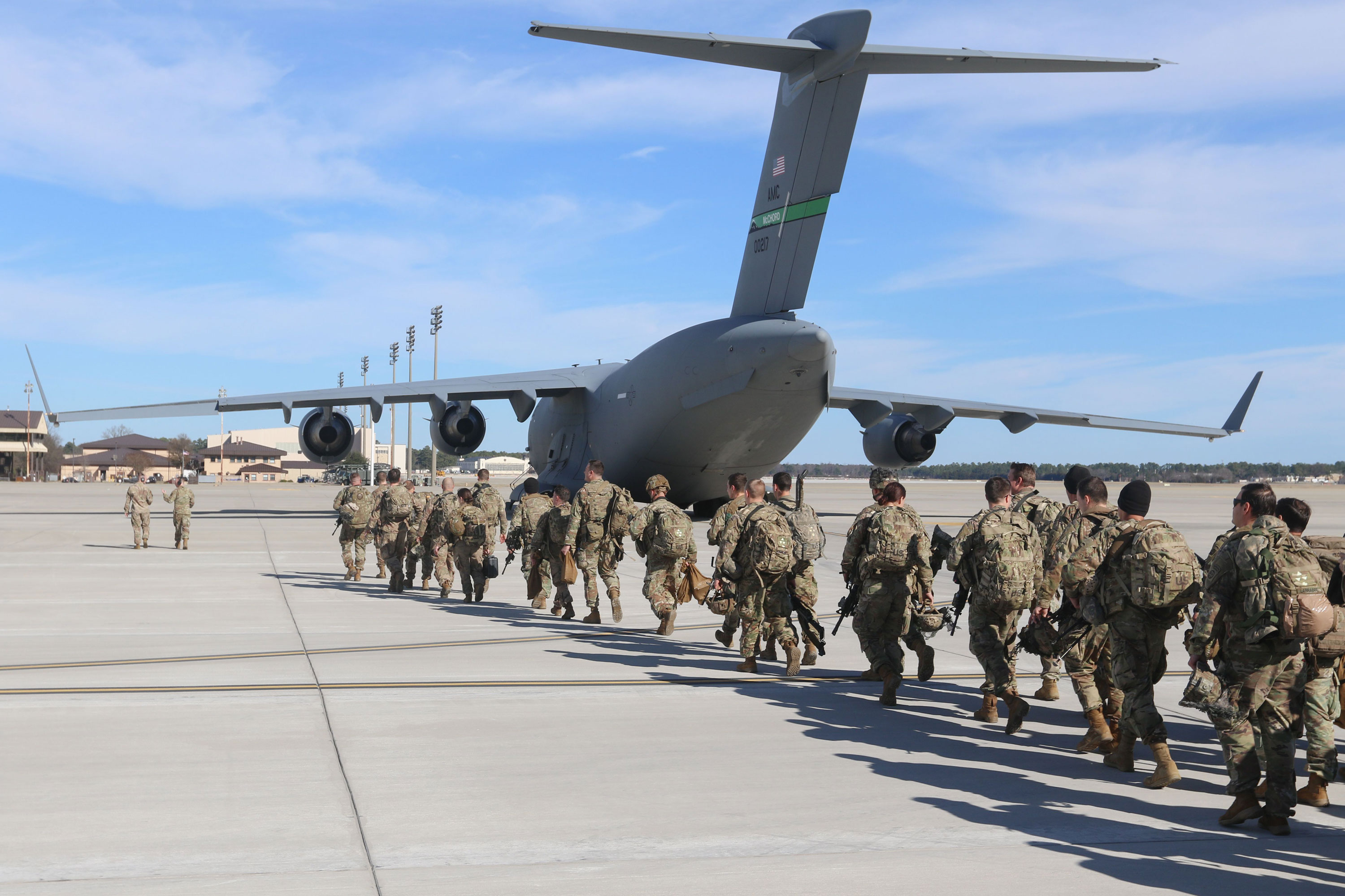 Paratroopers assigned to the 2nd Battalion, 504th Parachute Infantry Regiment, 1st Brigade Combat Team, 82nd Airborne Division, deploy from Pope Army Airfield in North Carolina on January 1.
