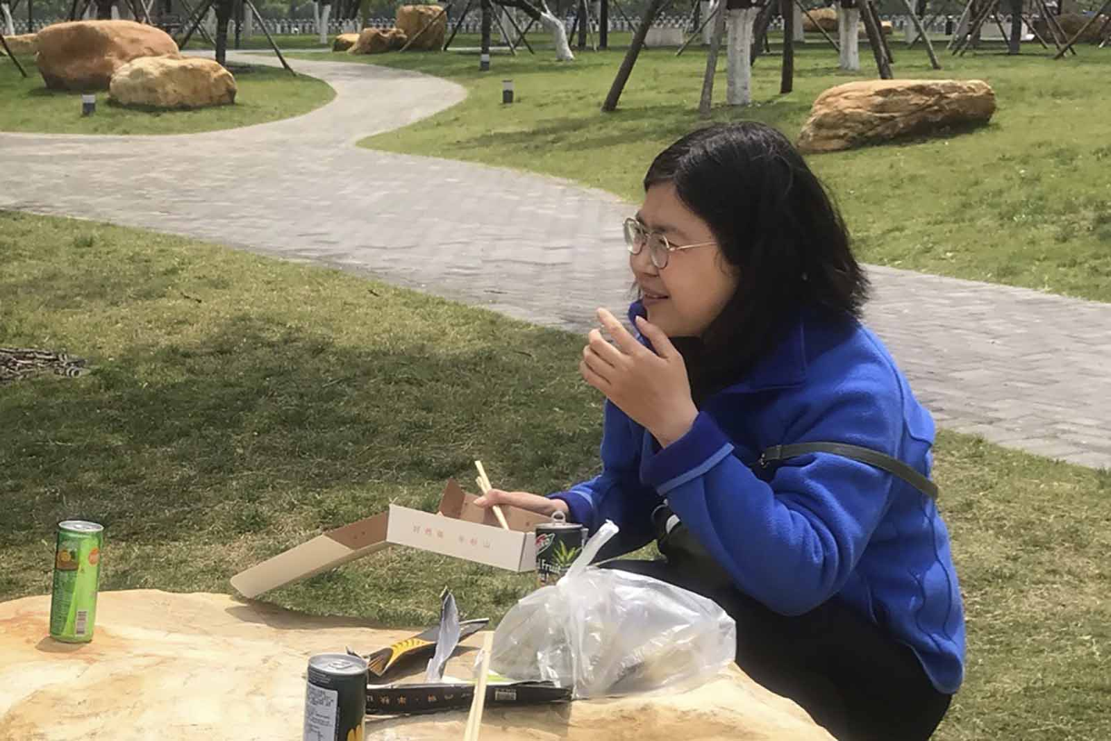 In this photo taken April 14, Zhang Zhan eats a meal at a park during a visit to Wuhan in China's Hubei province.