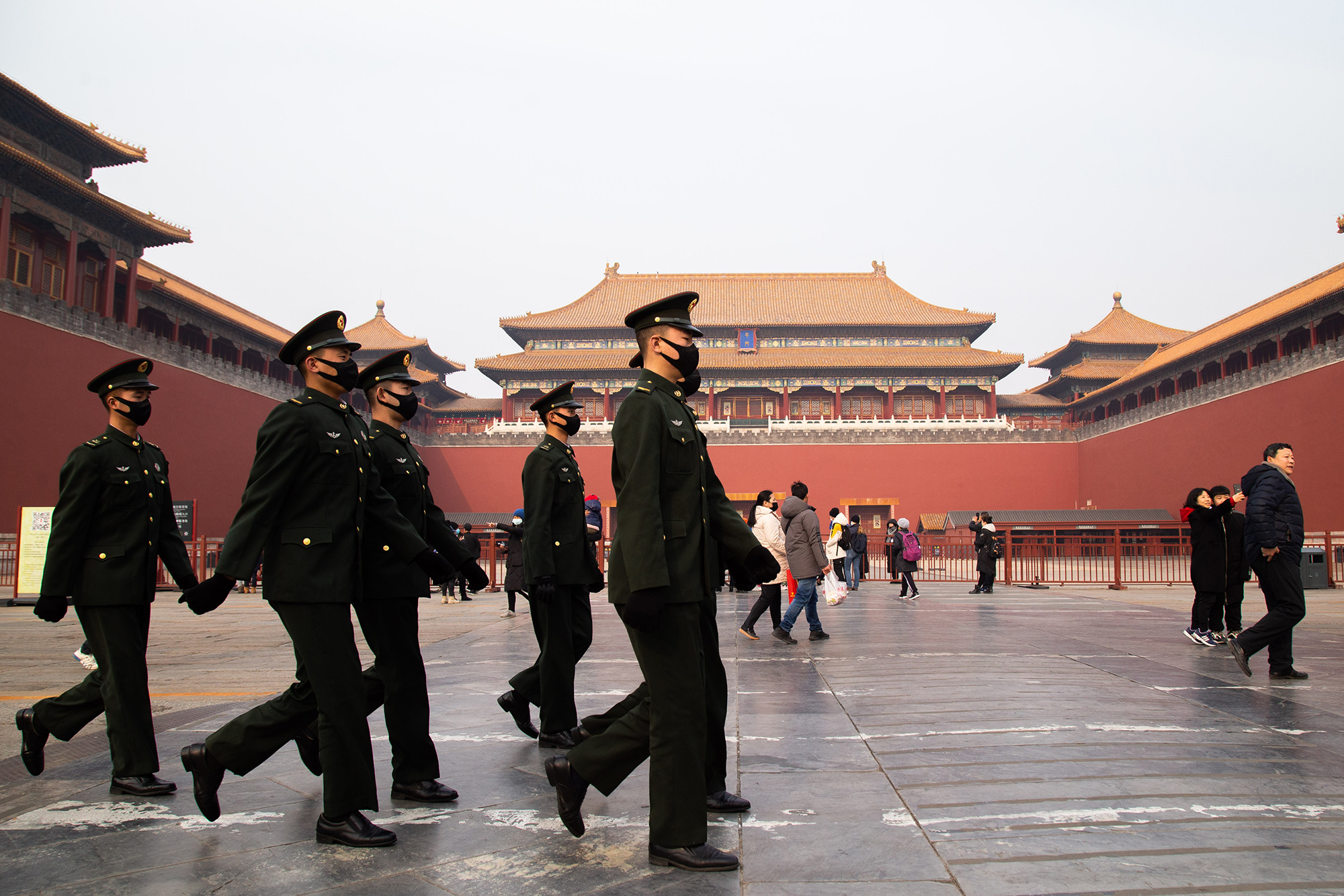 Chinese police officers walk in front of the gated entrance of The Palace Museum on January 26, in Beijing, China.