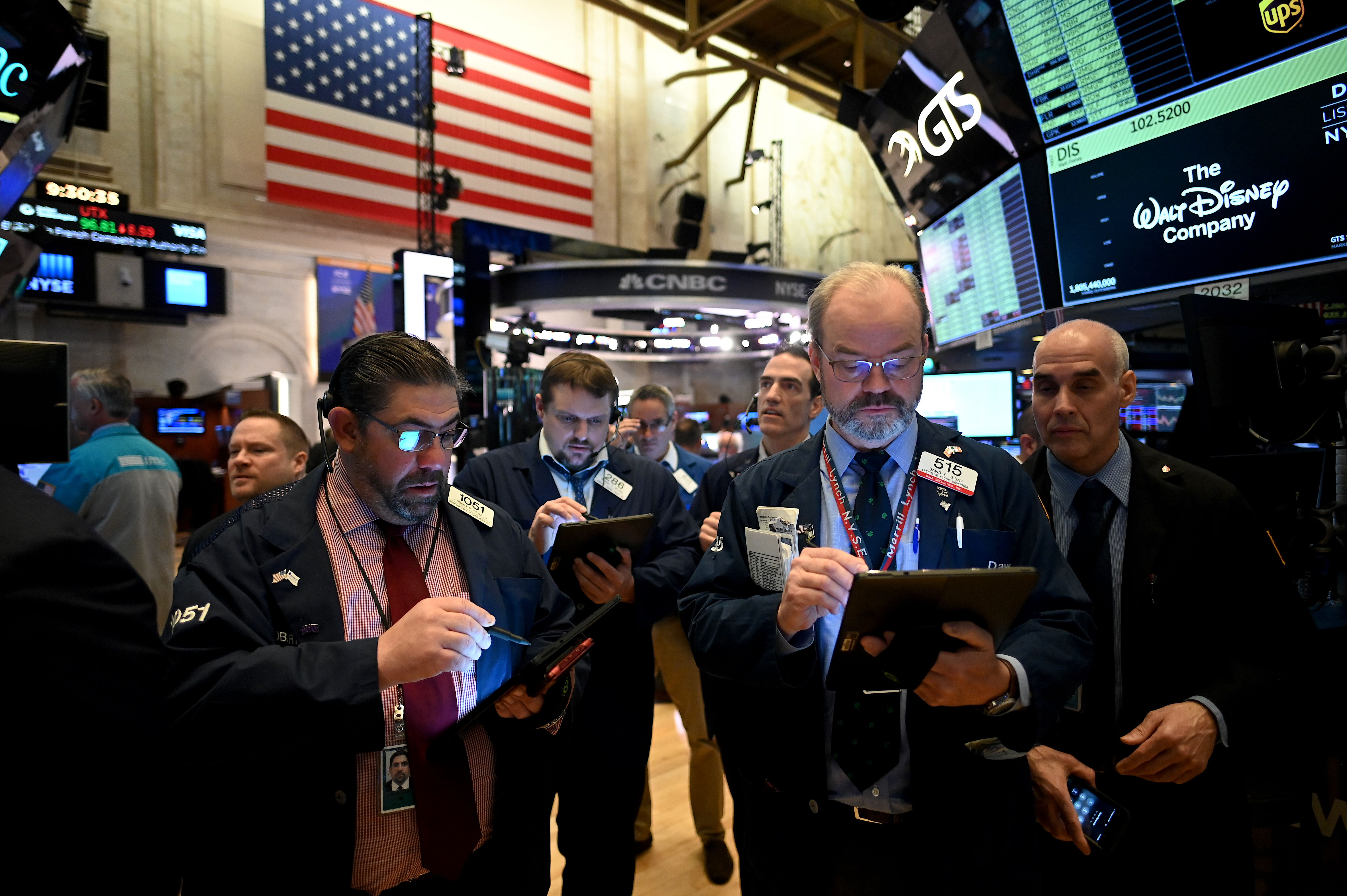 Traders work during the opening bell at the New York Stock Exchange (NYSE) on Monday, March 16.