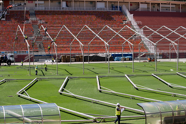 The field of the Pacaembu stadium is lined with metal frames as workers erect an open-air hospital to treat patients in Sao Paulo, Brazil, Monday, March 23. (
