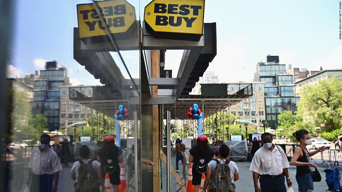 People walk past a Best Buy store near Union Square on June 25 in New York.