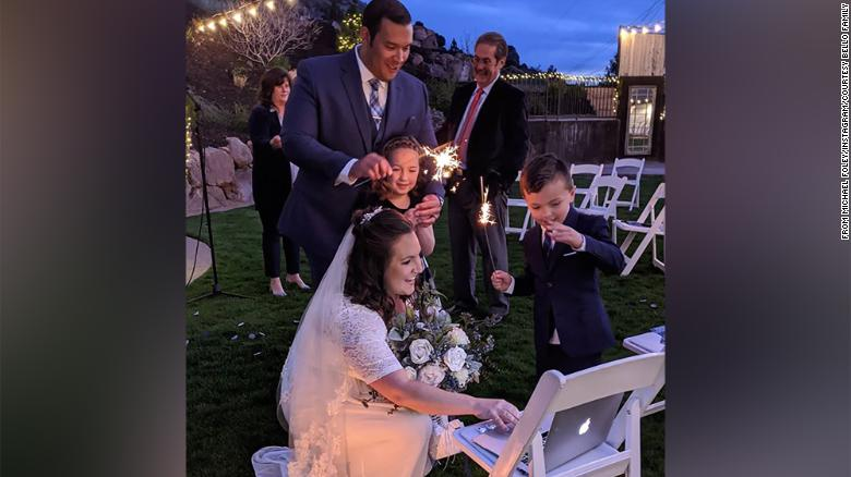 Marisa and Luis Bello set up a laptop to livestream their wedding, held on April 3 in Utah.