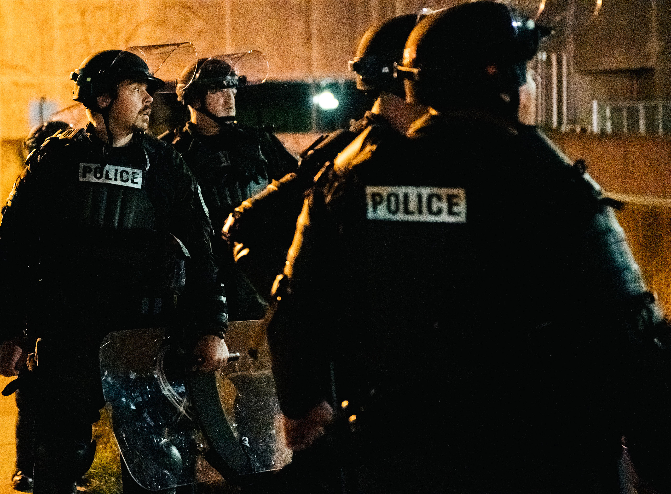 Police officers stand guard near government buildings on August 27 in Kenosha, Wisconsin.