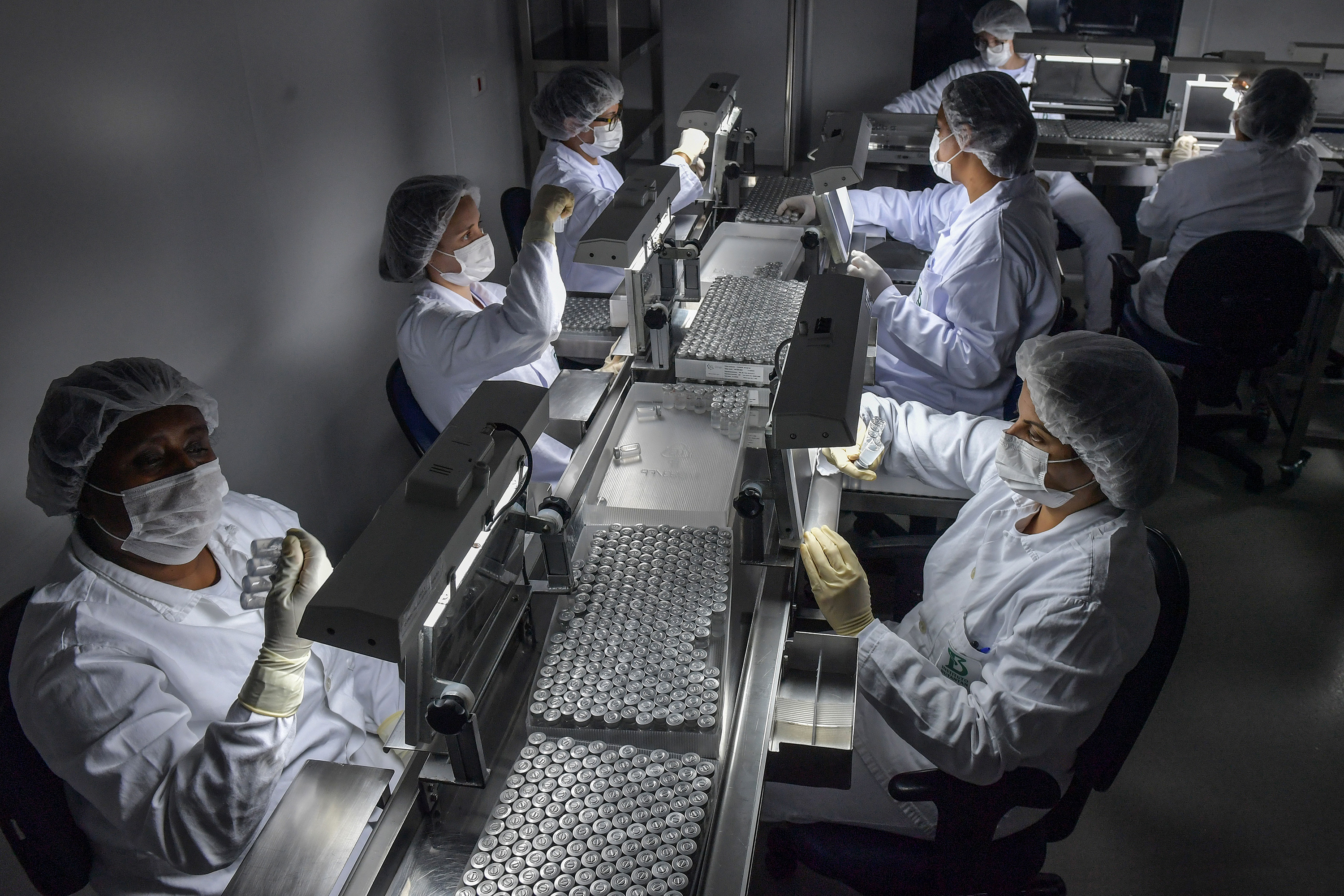 Staff prepare CoronaVac vaccines at the Butantan biomedical production center, in São Paulo, Brazil, on January 14.