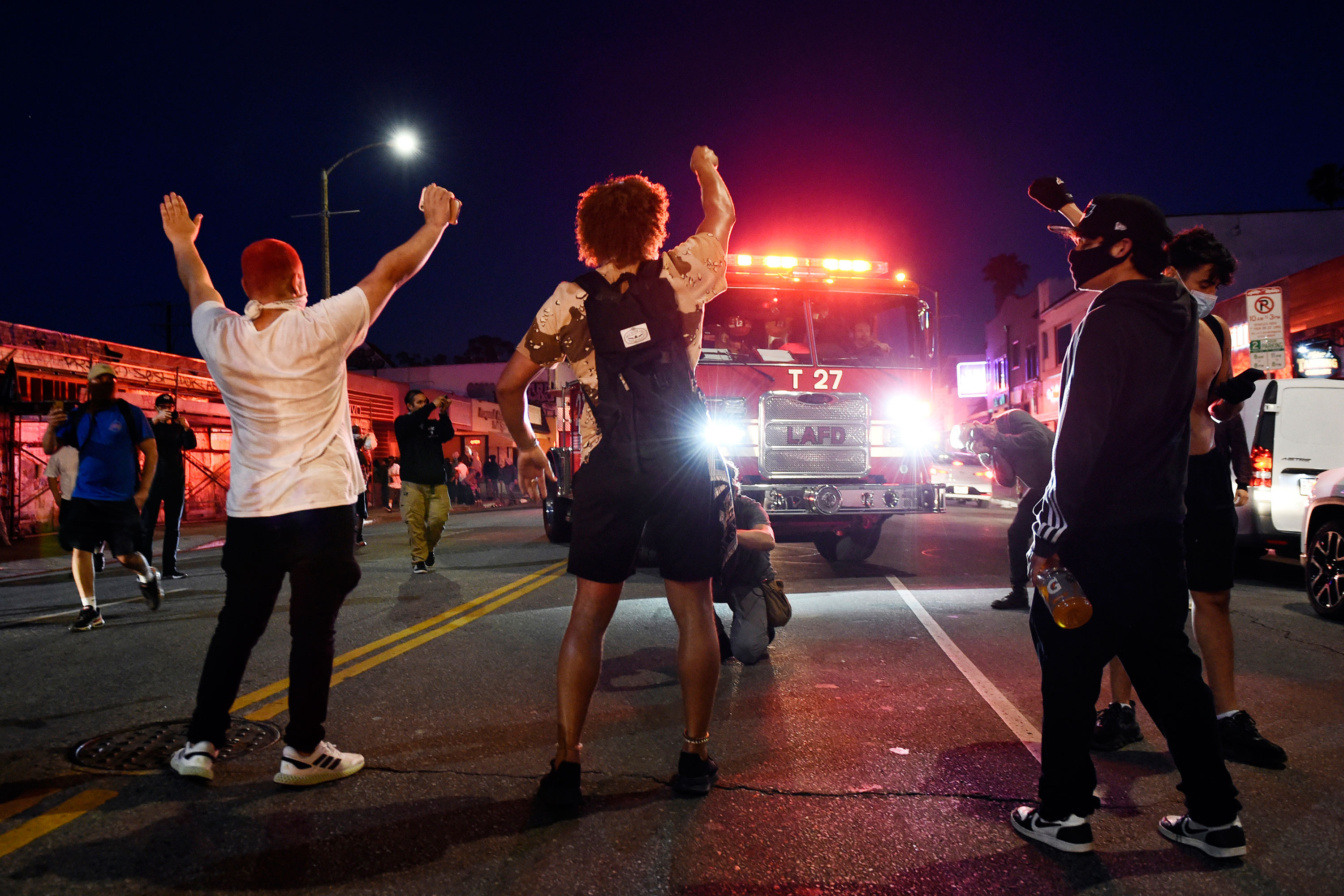 Demonstrators stand in the middle of Melrose Avenue on Saturday night in Los Angeles.