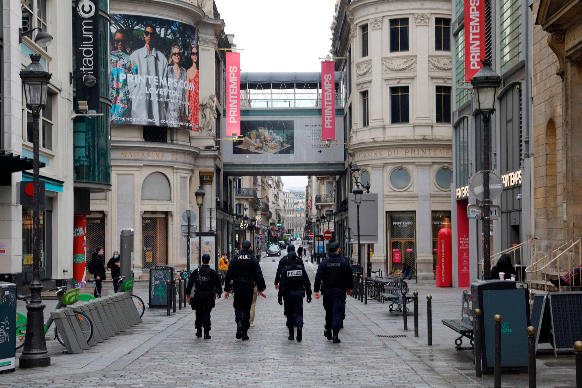 Policemen patrol near Le Printemps shopping center in Paris on January 31.