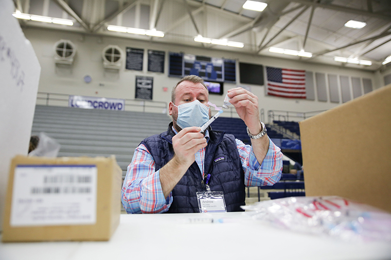 Walgreens staff prepare vaccines for Educational Staff at Kettering City Schools to receive the Covid-19 vaccine as a part of Ohios Phase 1B vaccine distribution in Dayton, Ohio on February 10. (
