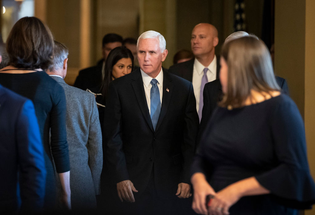 Vice President Mike Pence walks to the Republican policy luncheon at the U.S. Capitol on Tuesday