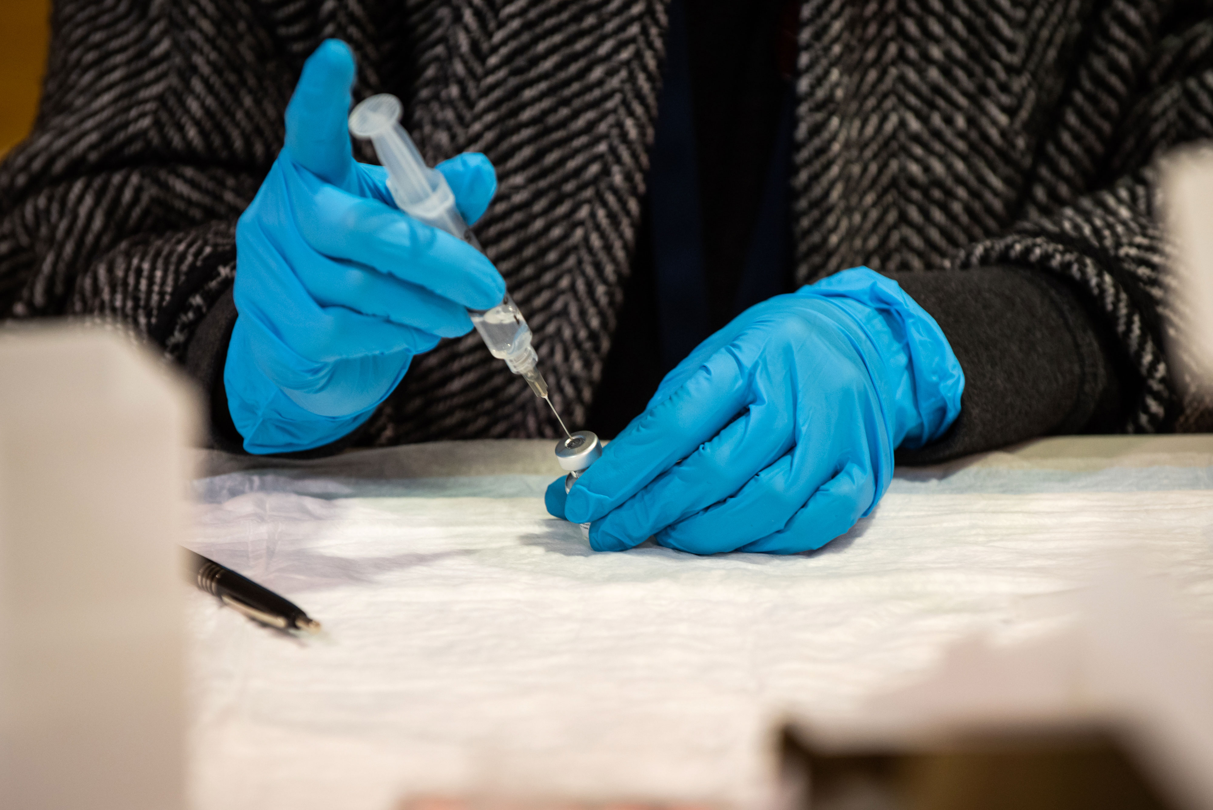 A health care worker prepares a syringe with the Pfizer/BioNTech Covid-19 vaccine in Gallup, New Mexico, on March 23.
