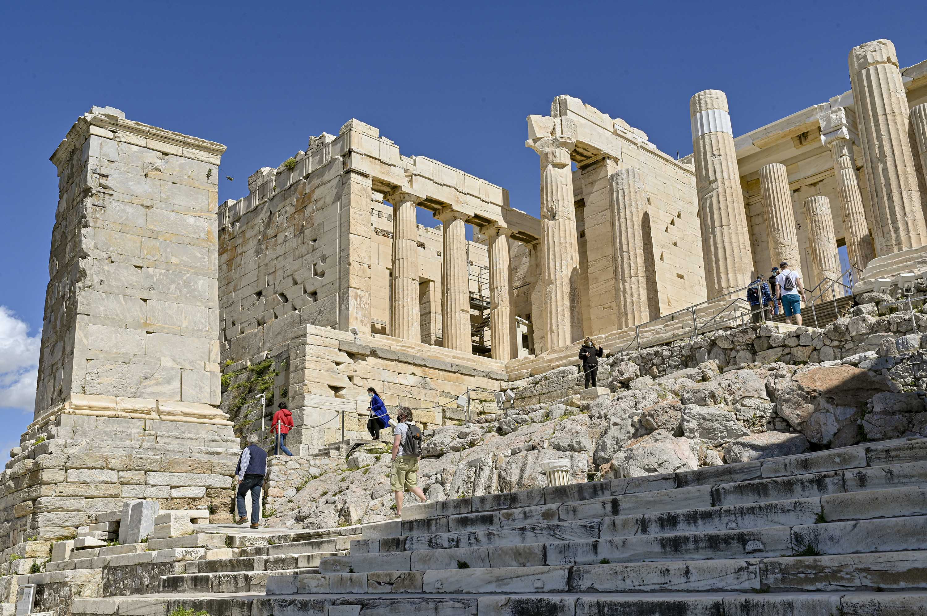 Visitors tour the the Athenian Acropolis on March 22, in Athens, Greece, after the site was reopened following the lifting of coronavirus restrictions.
