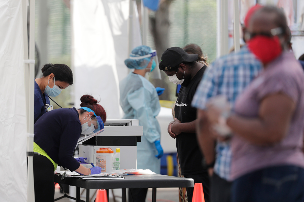 People register to be tested for Covid-19 at the West Perrine Health Center on Thursday, May 28, in Miami.