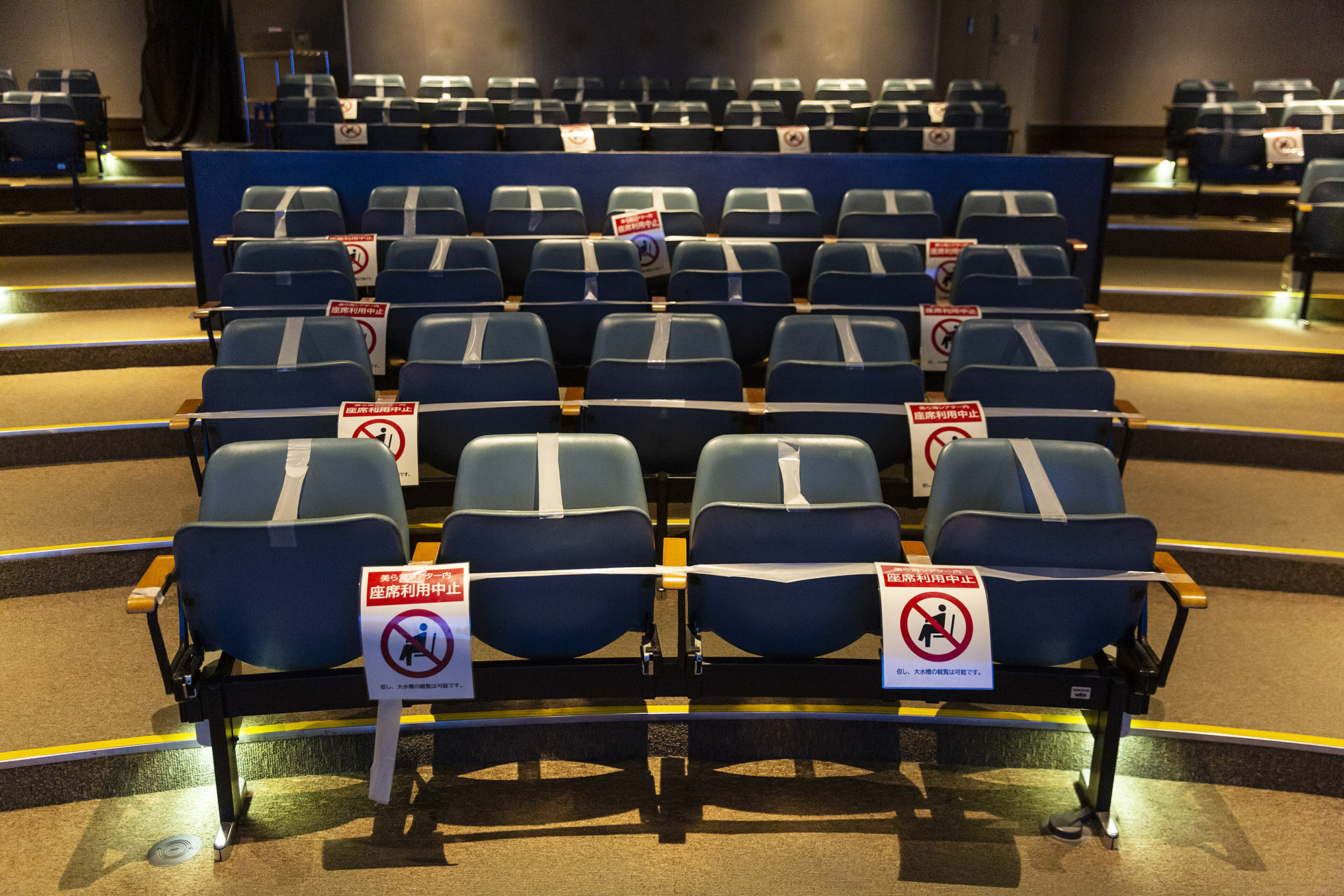 Notices are placed on seats in the Okinawa Churaumi Aquarium requesting that people don't sit down as a measure to protect against spreading coronavirus, on November 28, in Kunigami, Japan.
