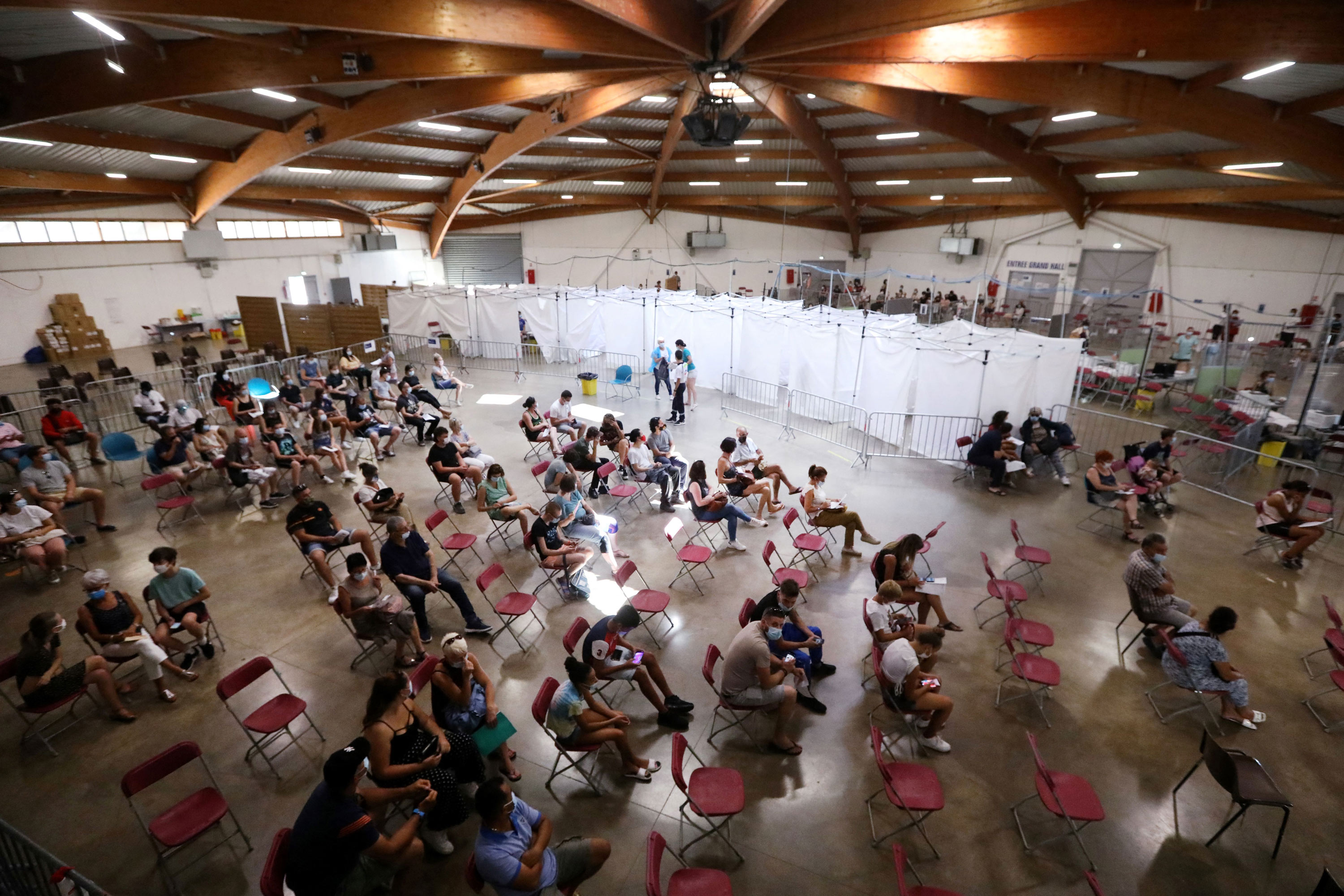 People wait to receive a dose of a Covid-19 vaccine at a vaccination center in Perpignan, France, on July 18.