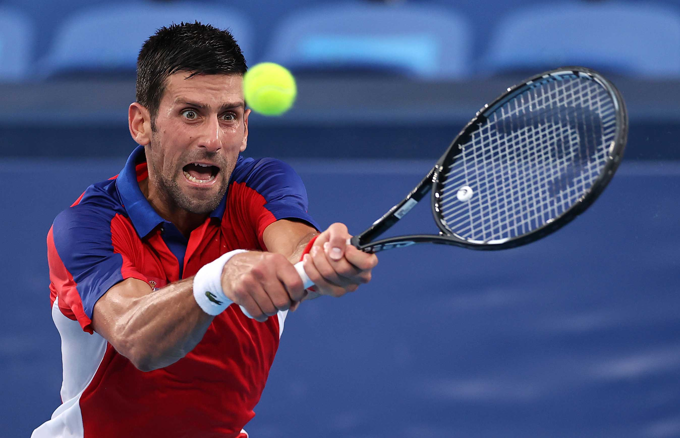 Novak Djokovic of Serbia plays a backhand during his Men's Singles Semifinal match against Alexander Zverev of Germany on July 30.