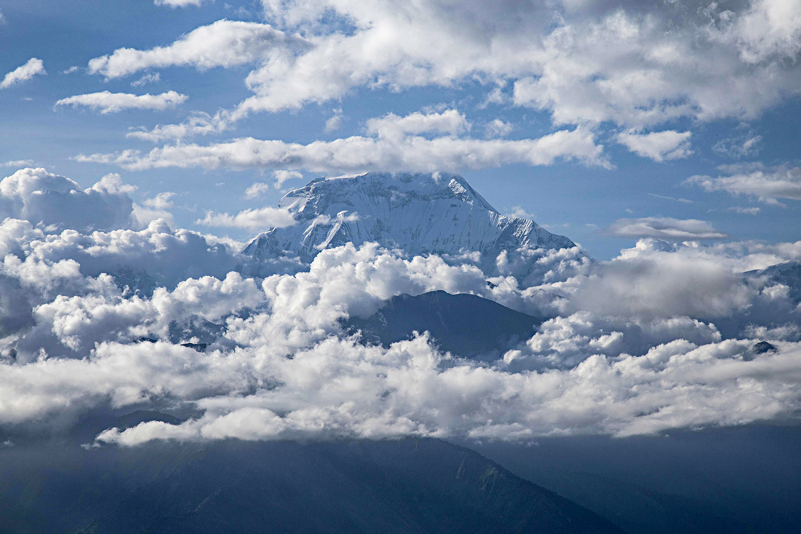 Mount Dhaulagiri is seen surrounded by clouds in Nepal, on August 22, 2019.
