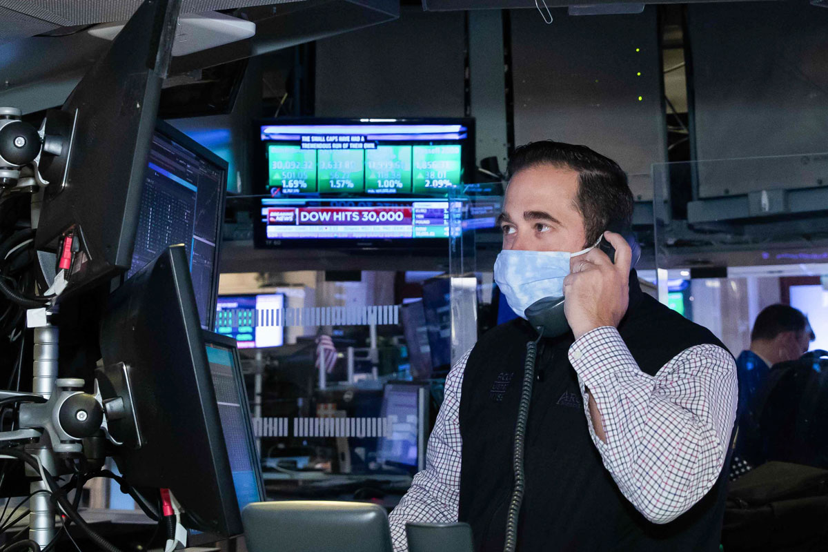 A trader at the New York Stock Exchange works at his terminal on November 24.