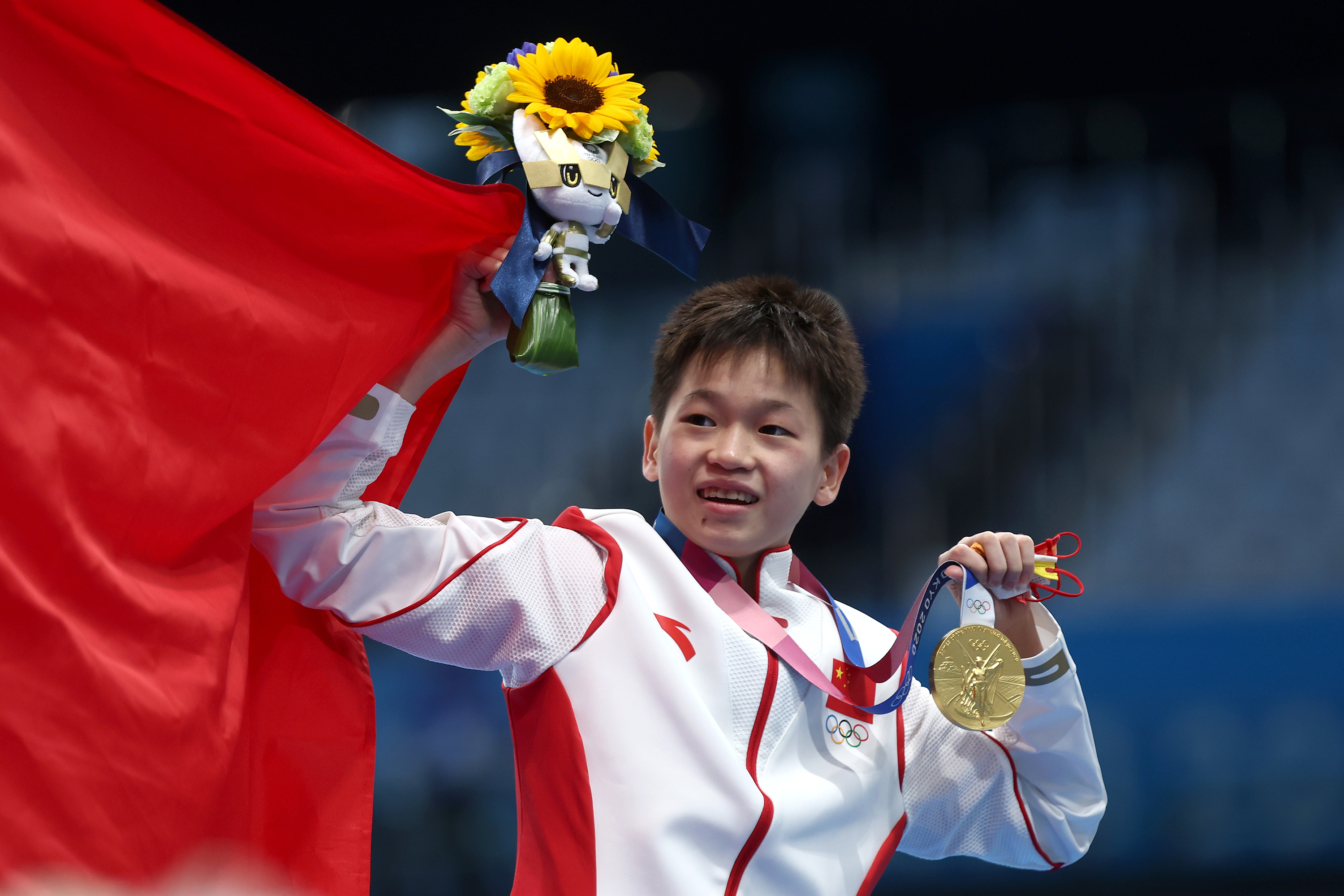 China's Quan Hongchan celebrates during the medal ceremony for the women's 10 meter platform final on August 5.