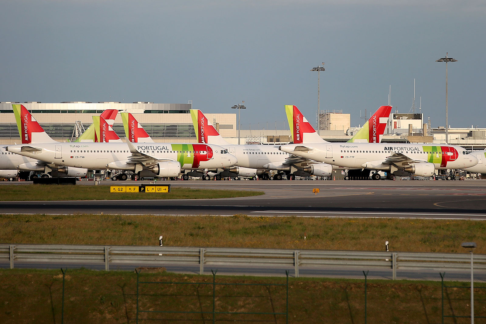 TAP Air Portugal planes are parked at Humberto Delgado Airport in Lisbon on March 24.
