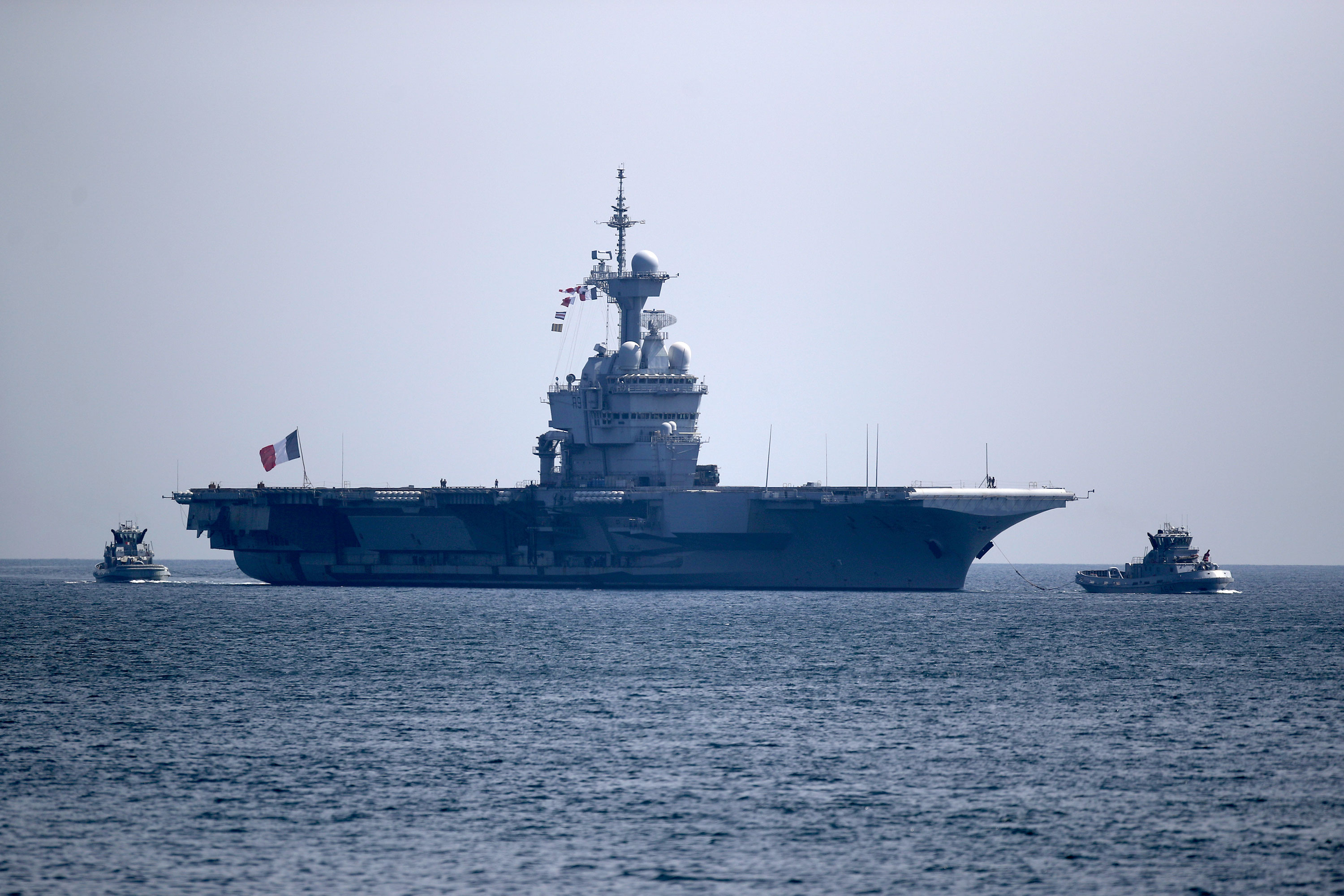 The French aircraft carrier Charles de Gaulle arrives in the bay of Toulon, France, on April 12.