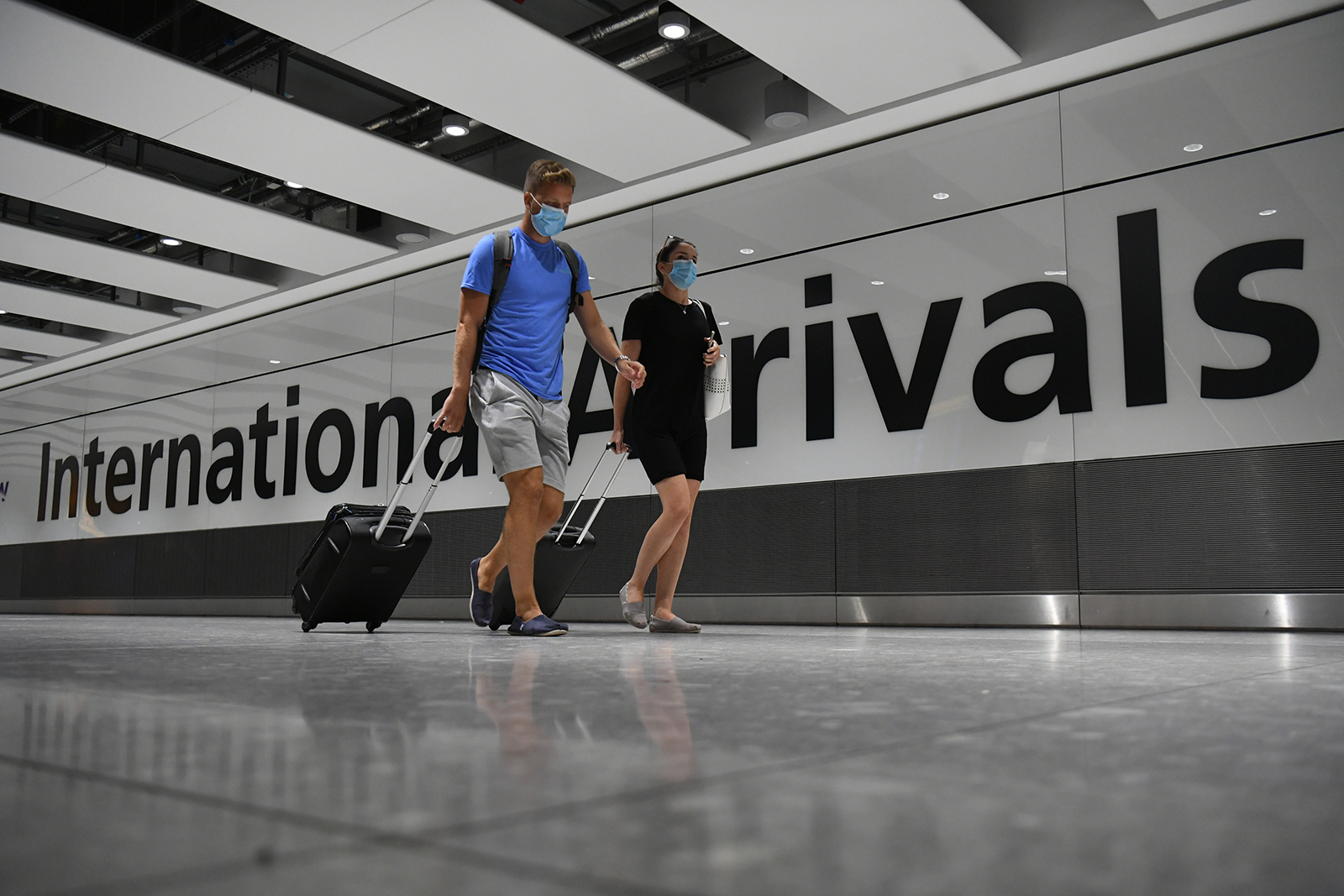 Passengers arrive at Heathrow Airport after a flight from Dubrovnik, Croatia, landed on August 21.