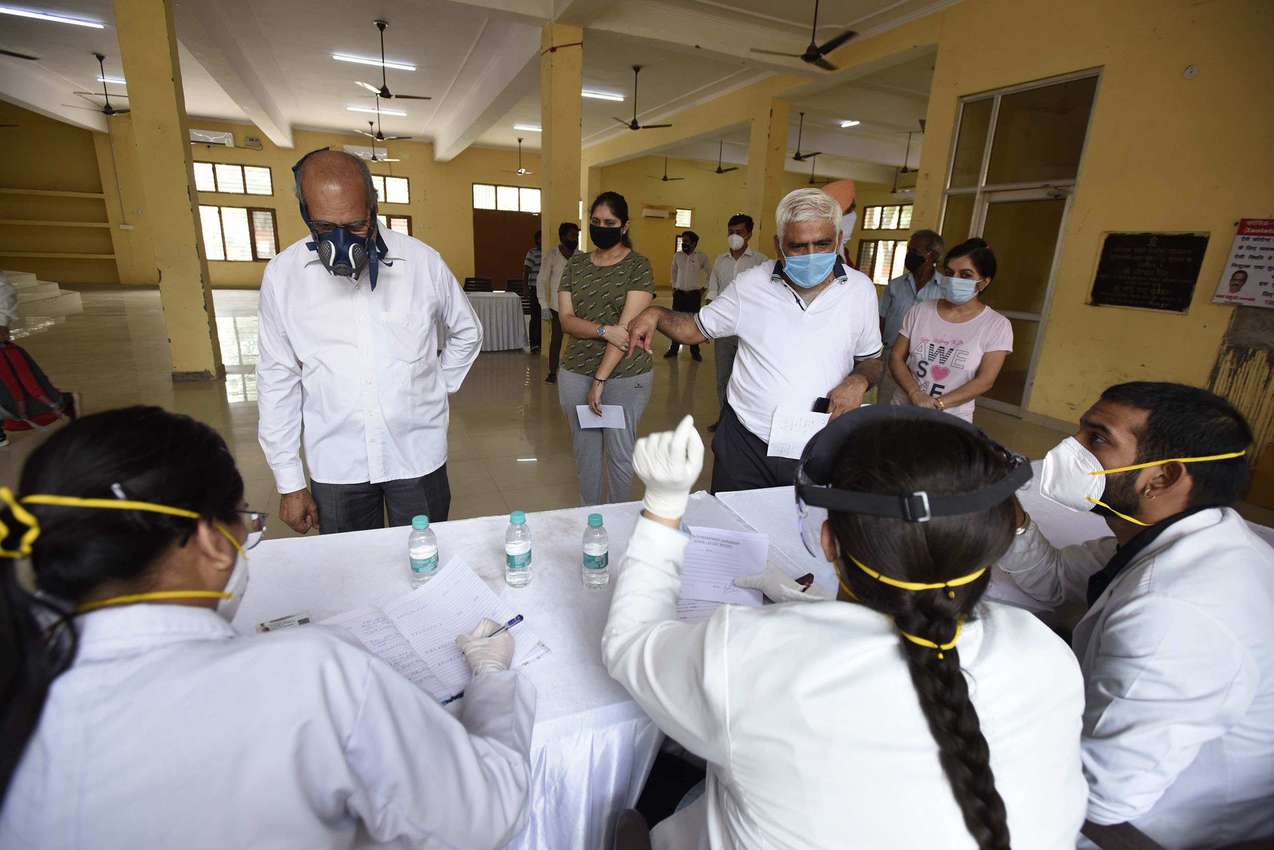 People register for coronavirus testing at a community center near the Huda Market, on July 18, in Gurugram, India.