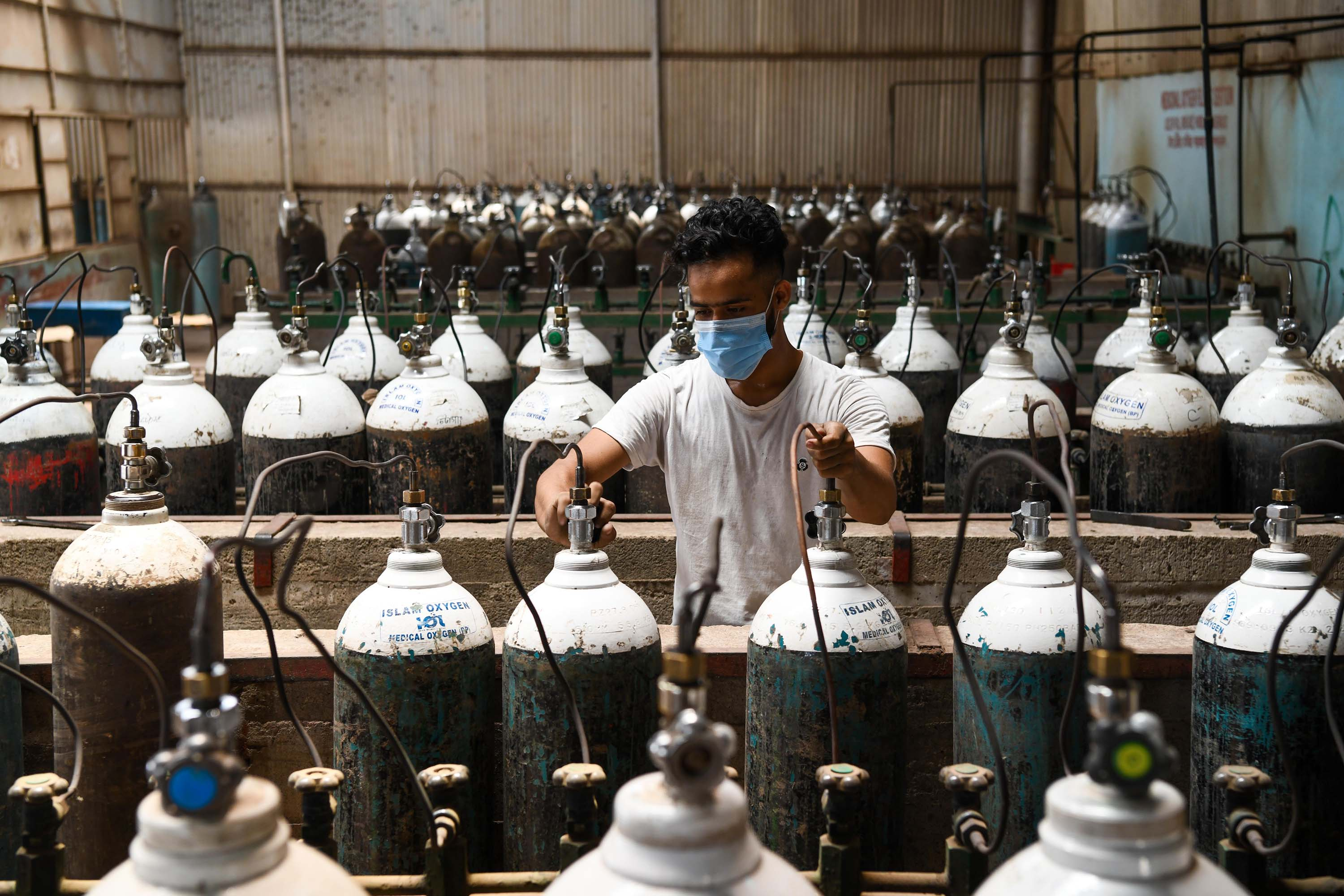 A worker refills cylinders at an oxygen plant in Dhaka, Bangladesh on April 23.