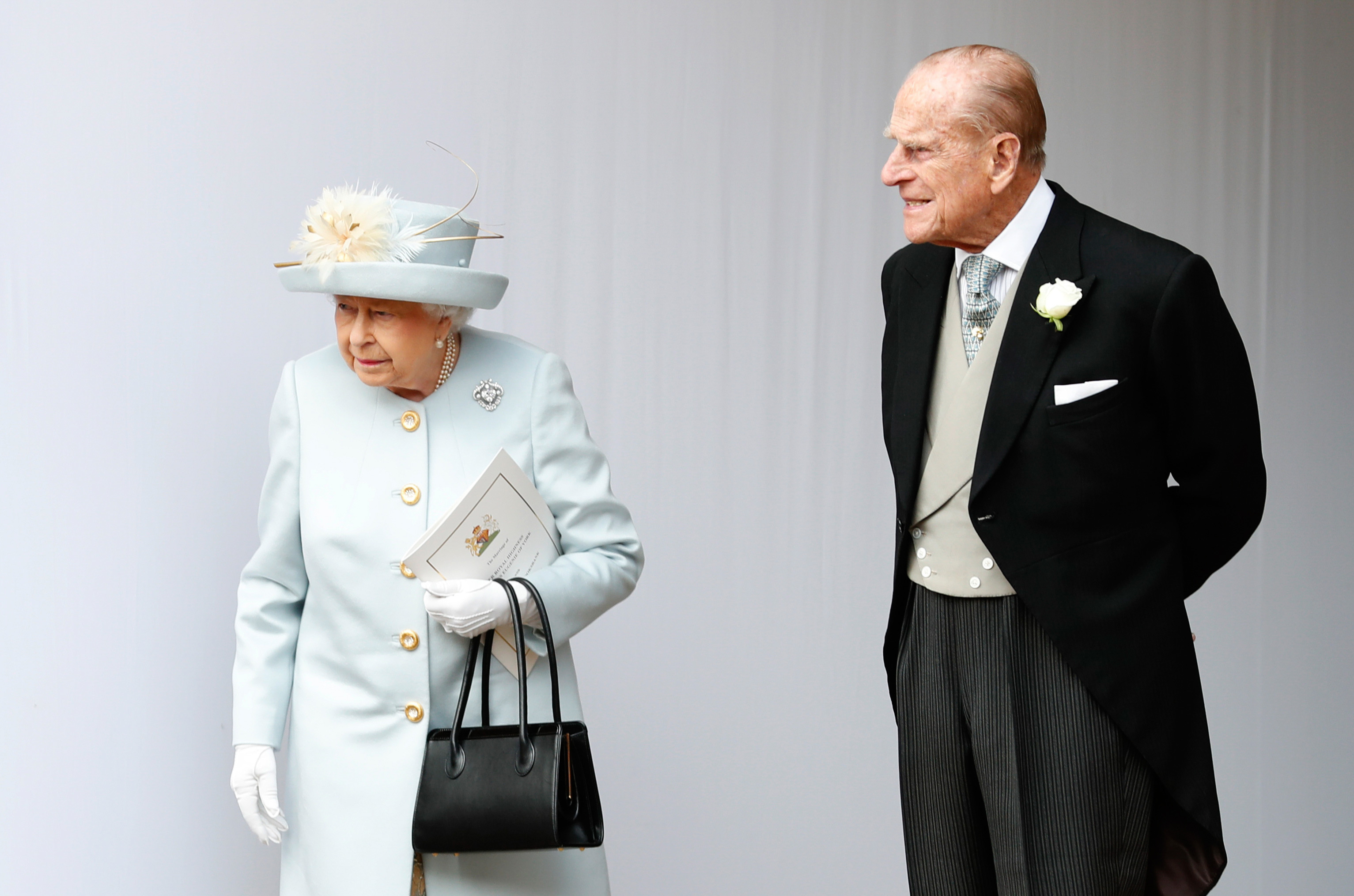 Britain's Queen Elizabeth II and Britain's Prince Philip, Duke of Edinburgh wait for a carriage at St George's Chapel, Windsor Castle, in Windsor, England, on October 12, 2018.