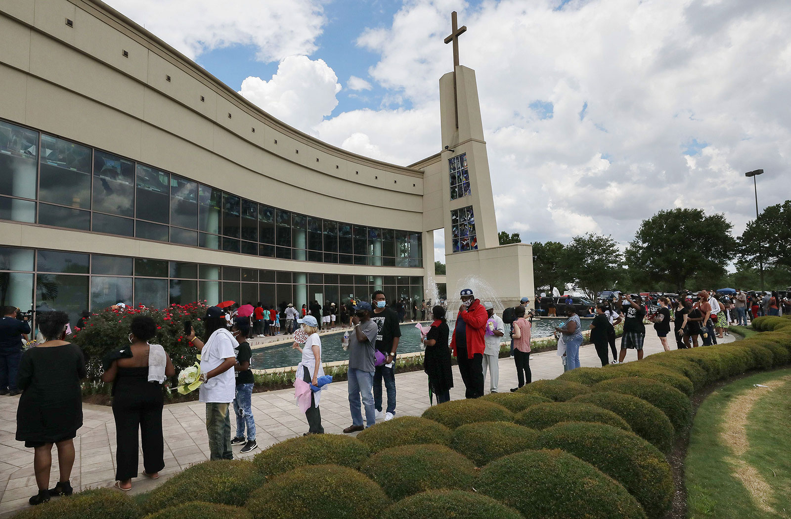 People wait in line to attend the public viewing for George Floyd outside the Fountain of Praise Church in Houston, Texas, on June 8.