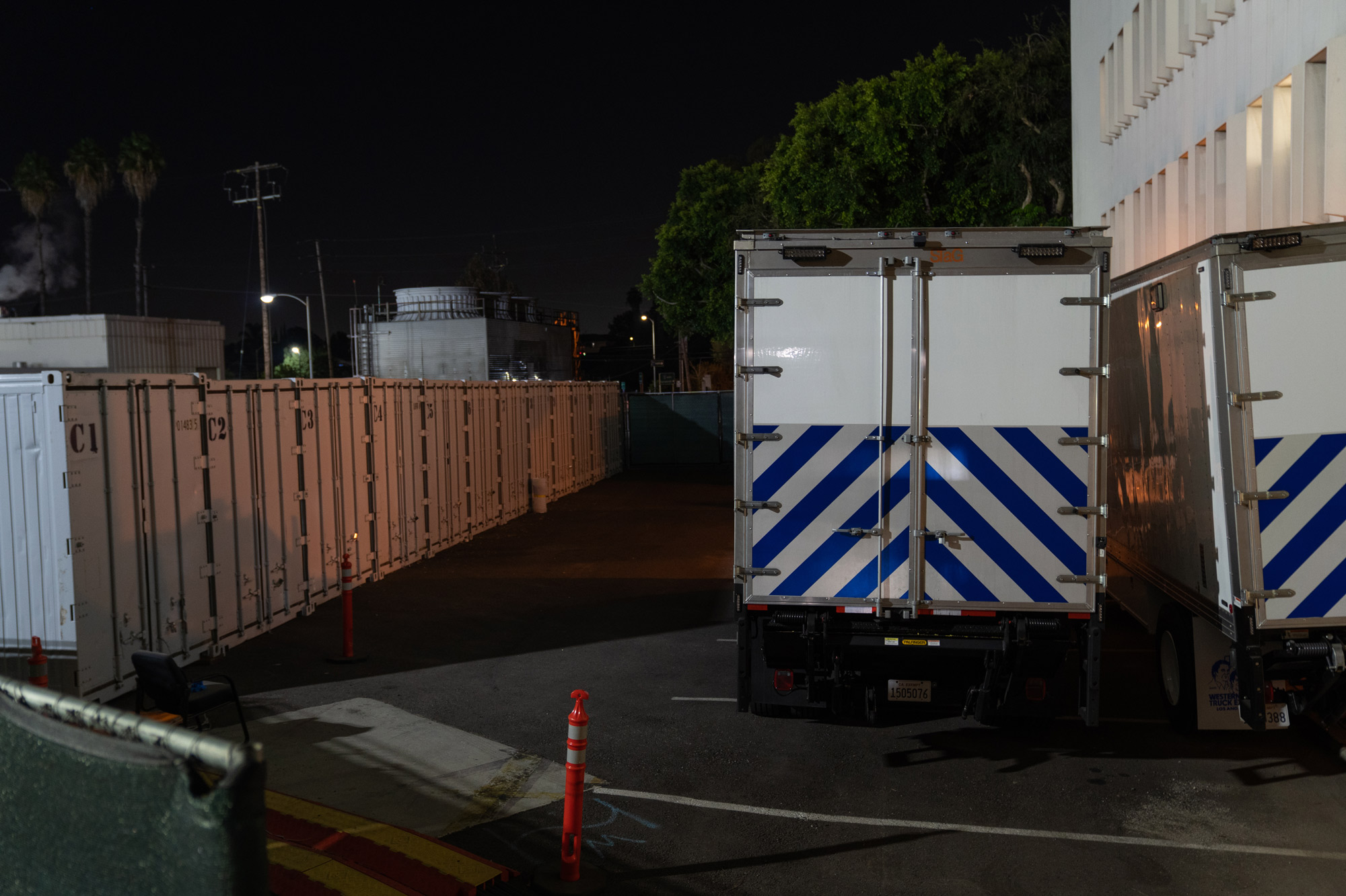 Refrigerated overflow morgue trailers and containers sit outside the Los Angeles County Department of Medical Examiner-Coroner in Los Angeles on January 6.