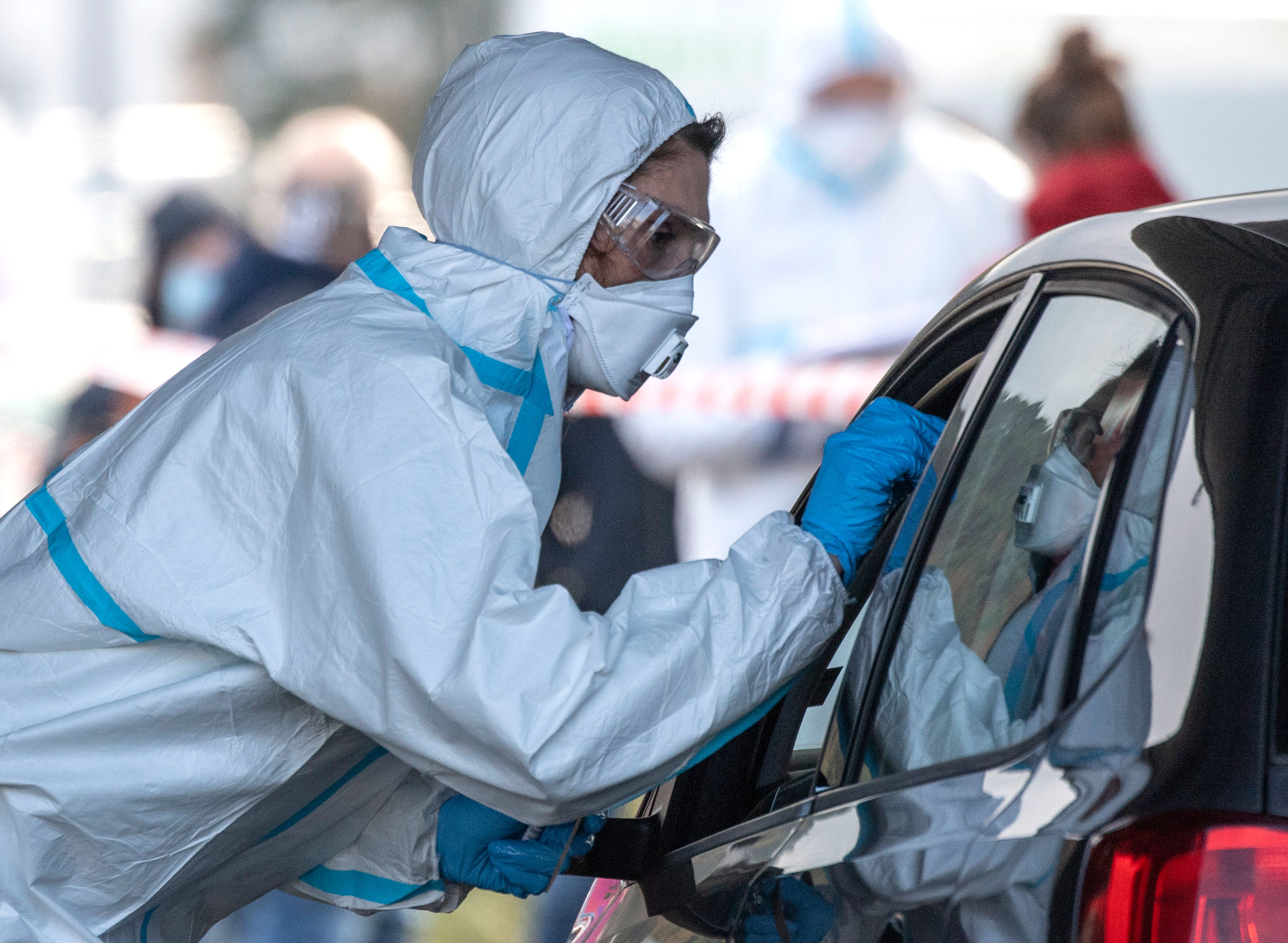 A worker administers Covid-19 tests at a drive-thru testing center in Marburg, Germany, on October 27.