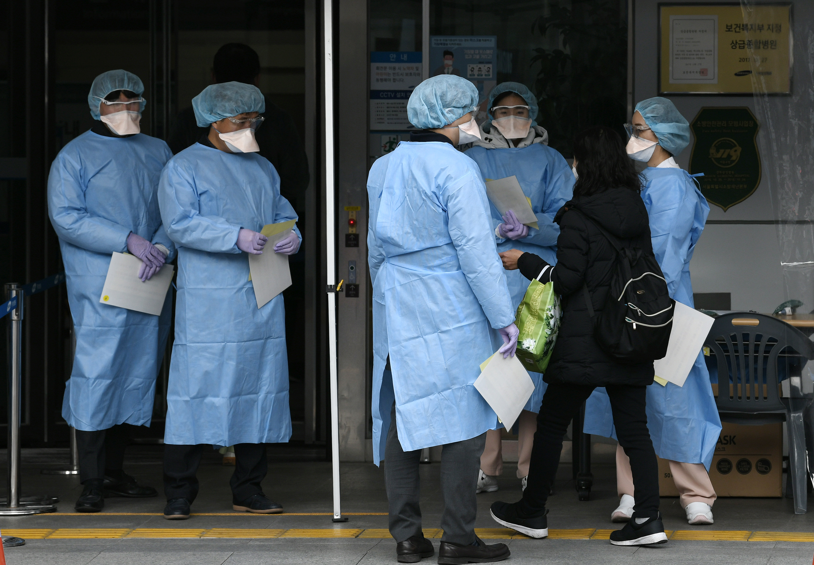 Medical officials in front of a hospital in Seoul on February 4, 2020.