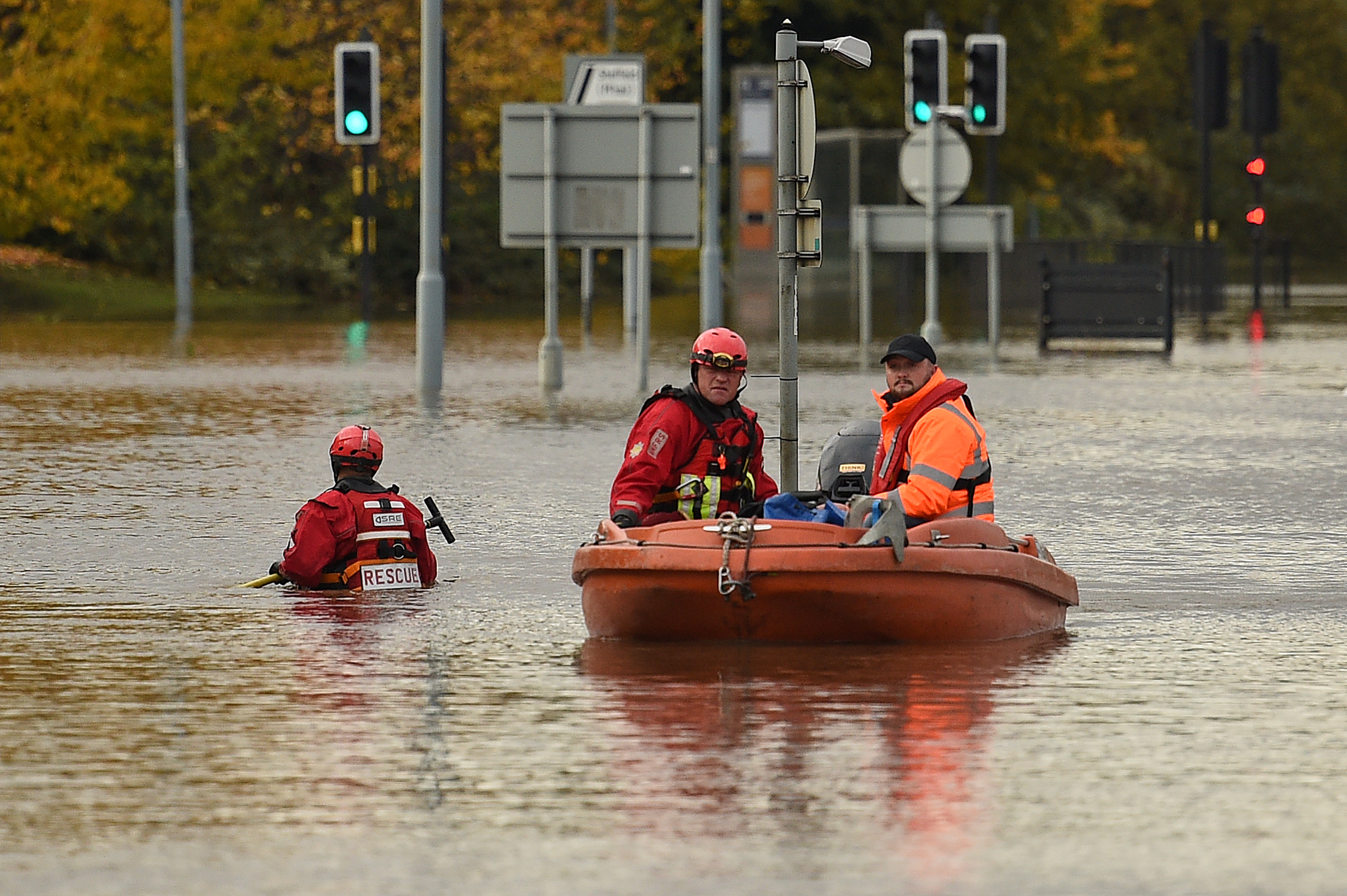 Members of the Fire and Rescue service make their way through flood water in a boat in South Yorkshire.