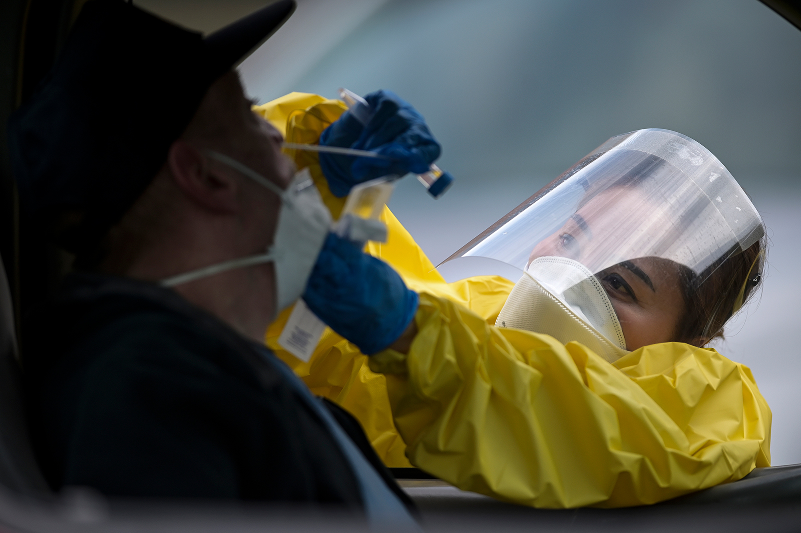 Elizabeth Santoro, a medic with the Minnesota Air National Guard 133rd Medical Group, administers a free Covid-19 test at the Minneapolis Armory on Saturday, May 23.