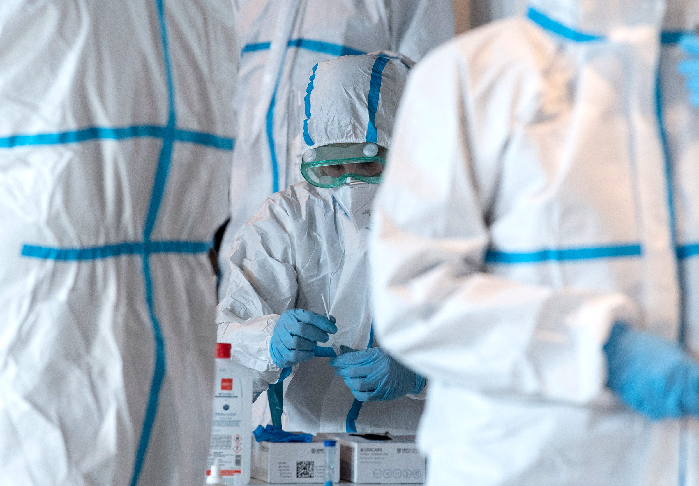 Employees process coronavirus test swabs at a testing center in Mainz, Germany, on March 26.