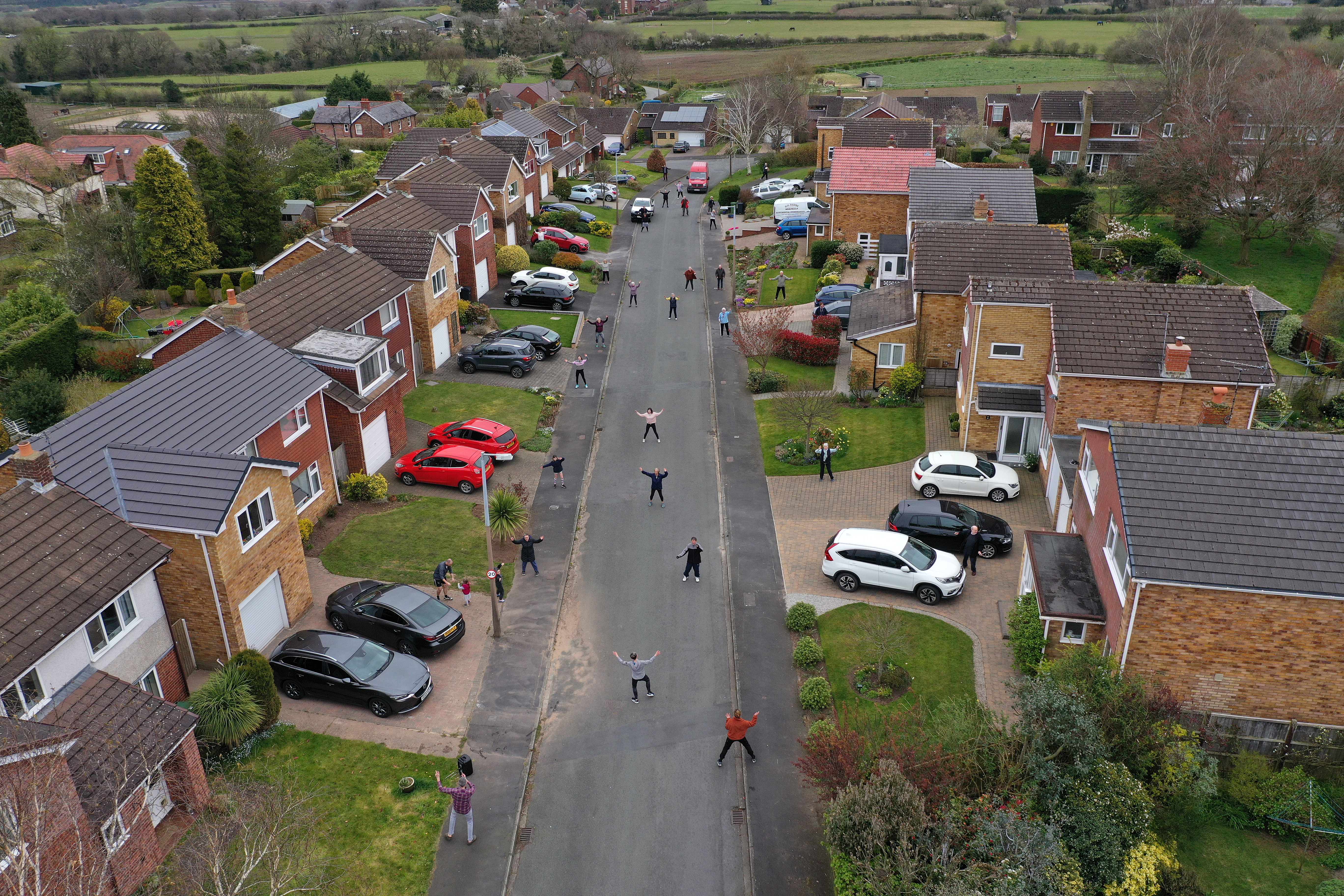 Neighbors in the town of Frodsham, England, participate in a daily social distance dancing and fitness event on April 4.