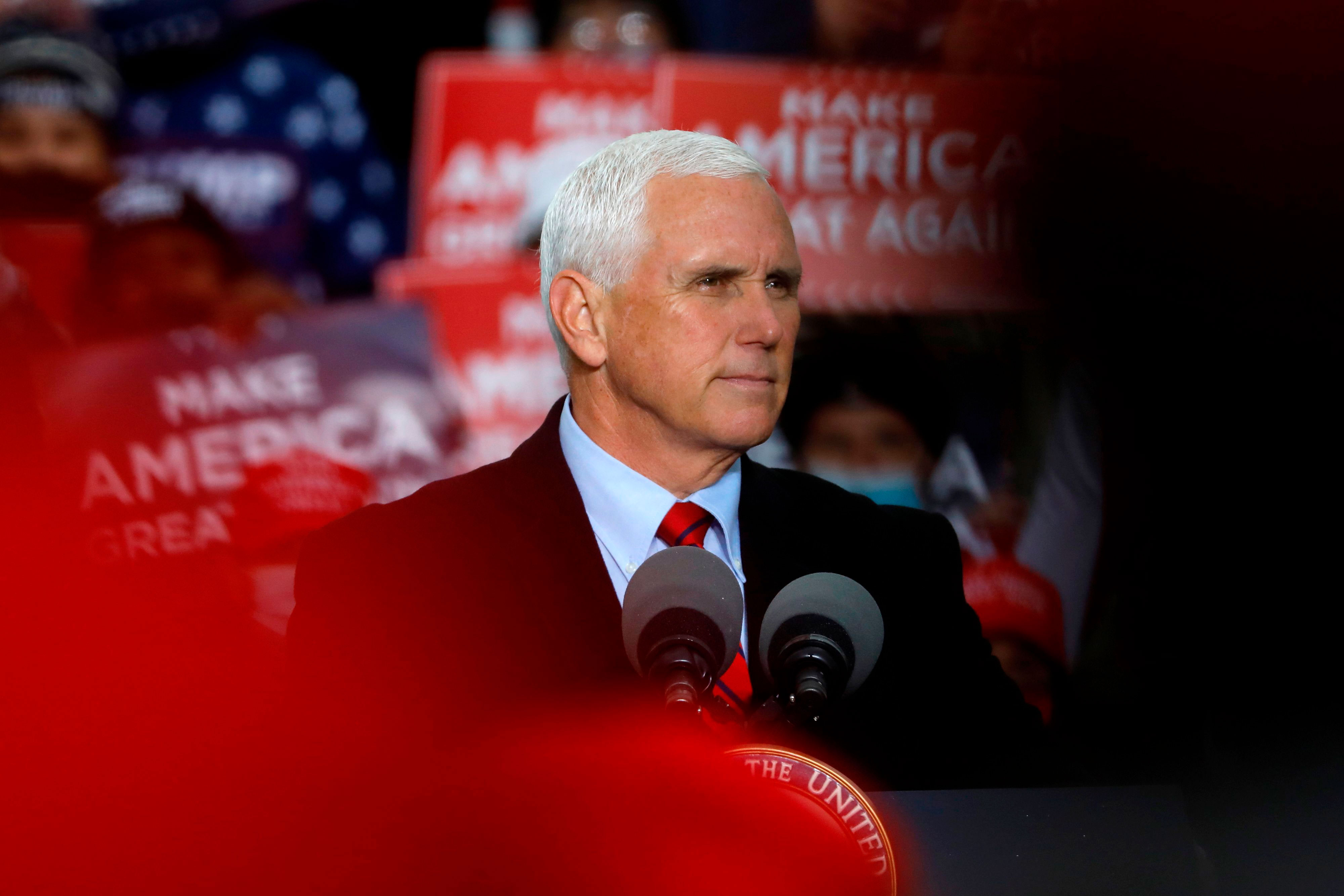 Vice President Mike Pence speaks during a campaign event at Oakland County International Airport in Waterford Township, Michigan, on October 22.