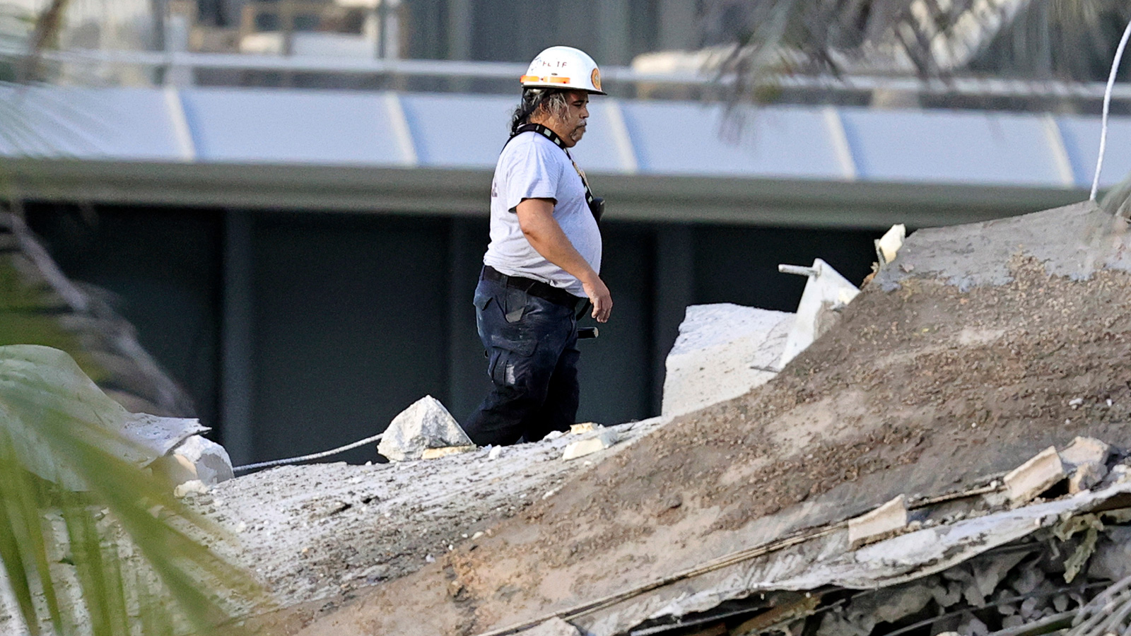 Fire rescue personnel conduct a search and rescue through the rubble of the Champlain Towers South Condo on Thursday.