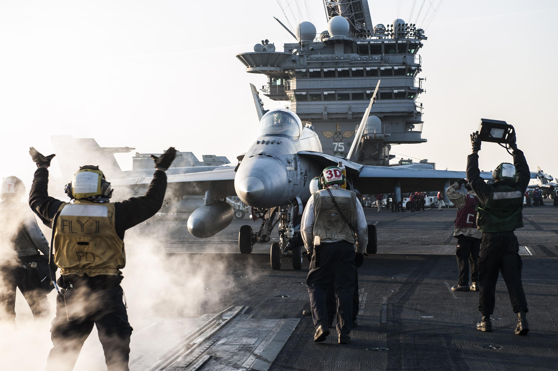 An F/A-18 fighter jet aboard a US aircraft carrier.