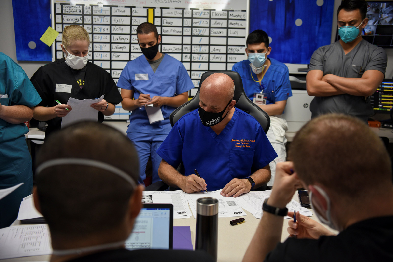 "Varon and his team go over patient files during a daily meeting. ""I'm afraid that at some point in time I'm going have to make some very serious decisions,"" Varon said in July. ""I'm starting to get the idea that I cannot save everybody."""