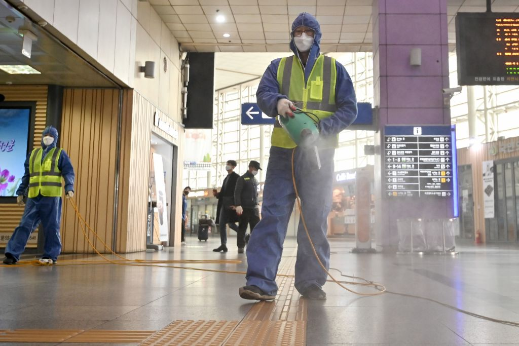 A worker  sprays disinfectant at a railway station in Daegu, South Korea, on February 26.