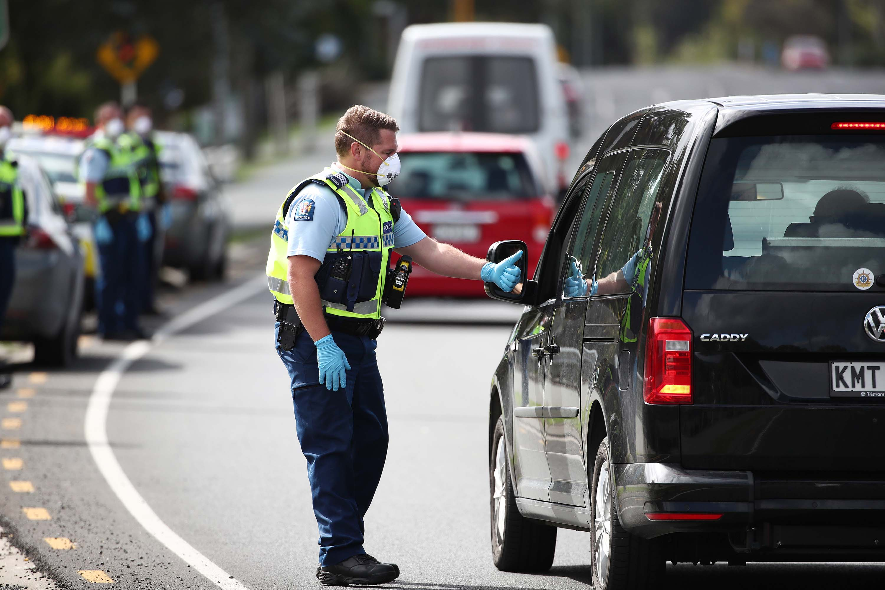 Police stop traffic during lockdown in Auckland, New Zealand, on April 9.