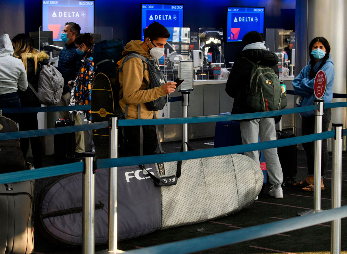 Passengers wait in line to check-in for Delta Air Lines flights at Los Angeles International Airport ahead of the Thanksgiving holiday in Los Angeles, California, November 25.